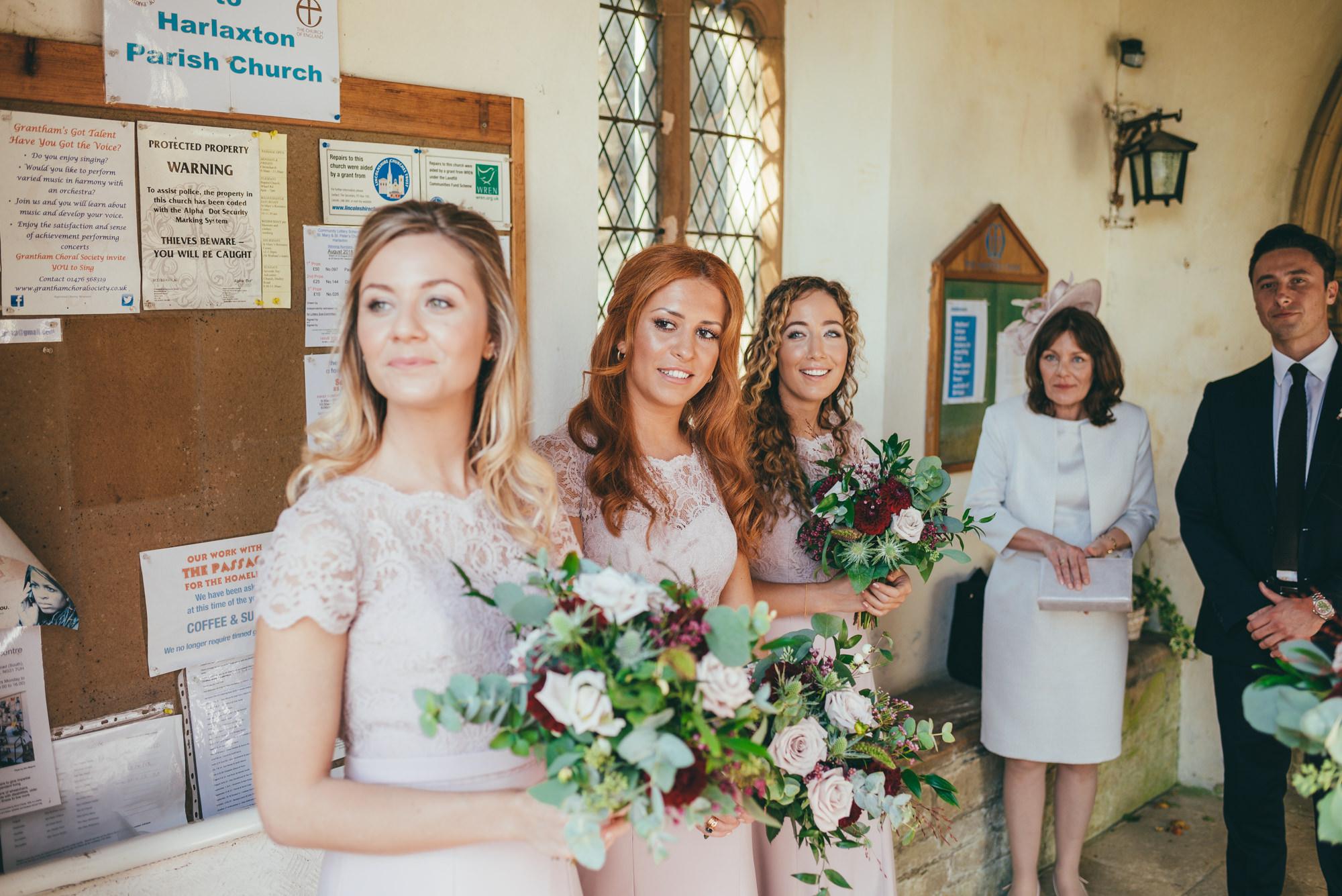 bridesmaids waiting for the bride at harlaxton church