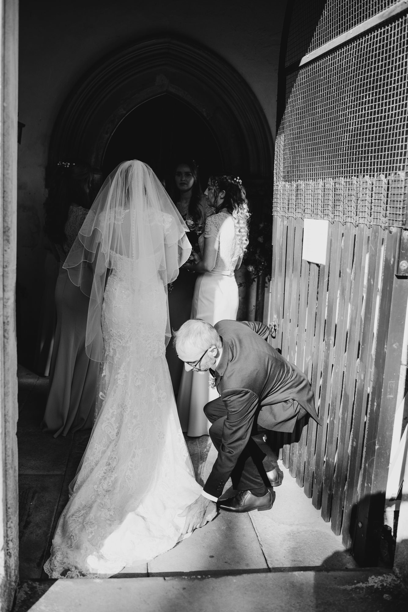 father fixing brides dress