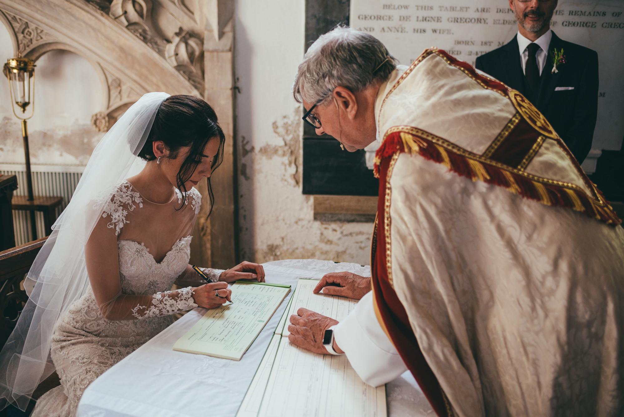 bride signing the wedding register