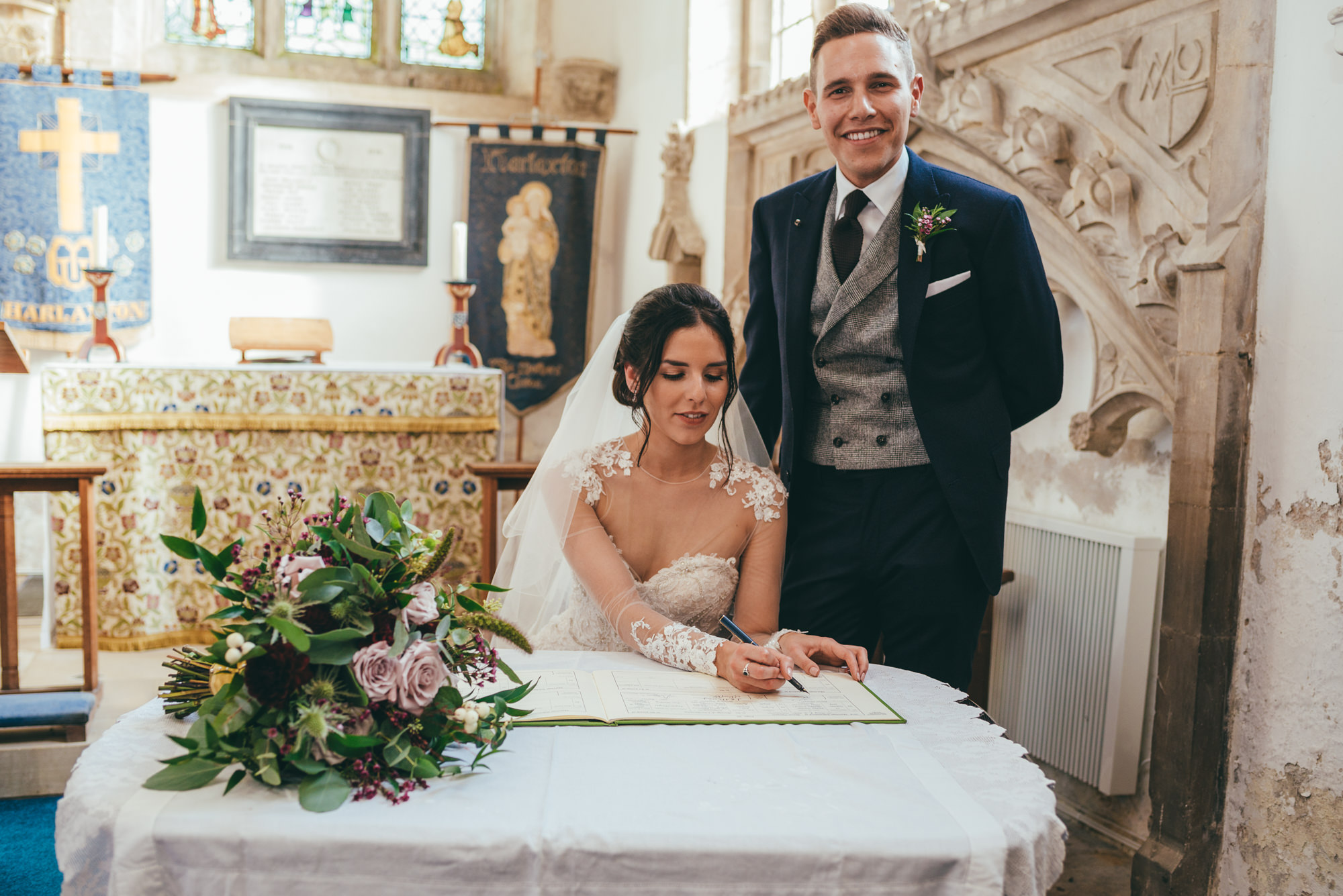photograph of the bride and groom signing the wedding register