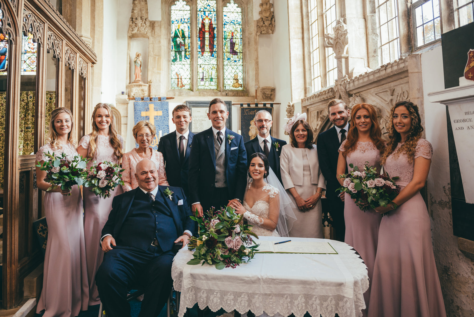posed photograph of the bridal party at harlaxton church