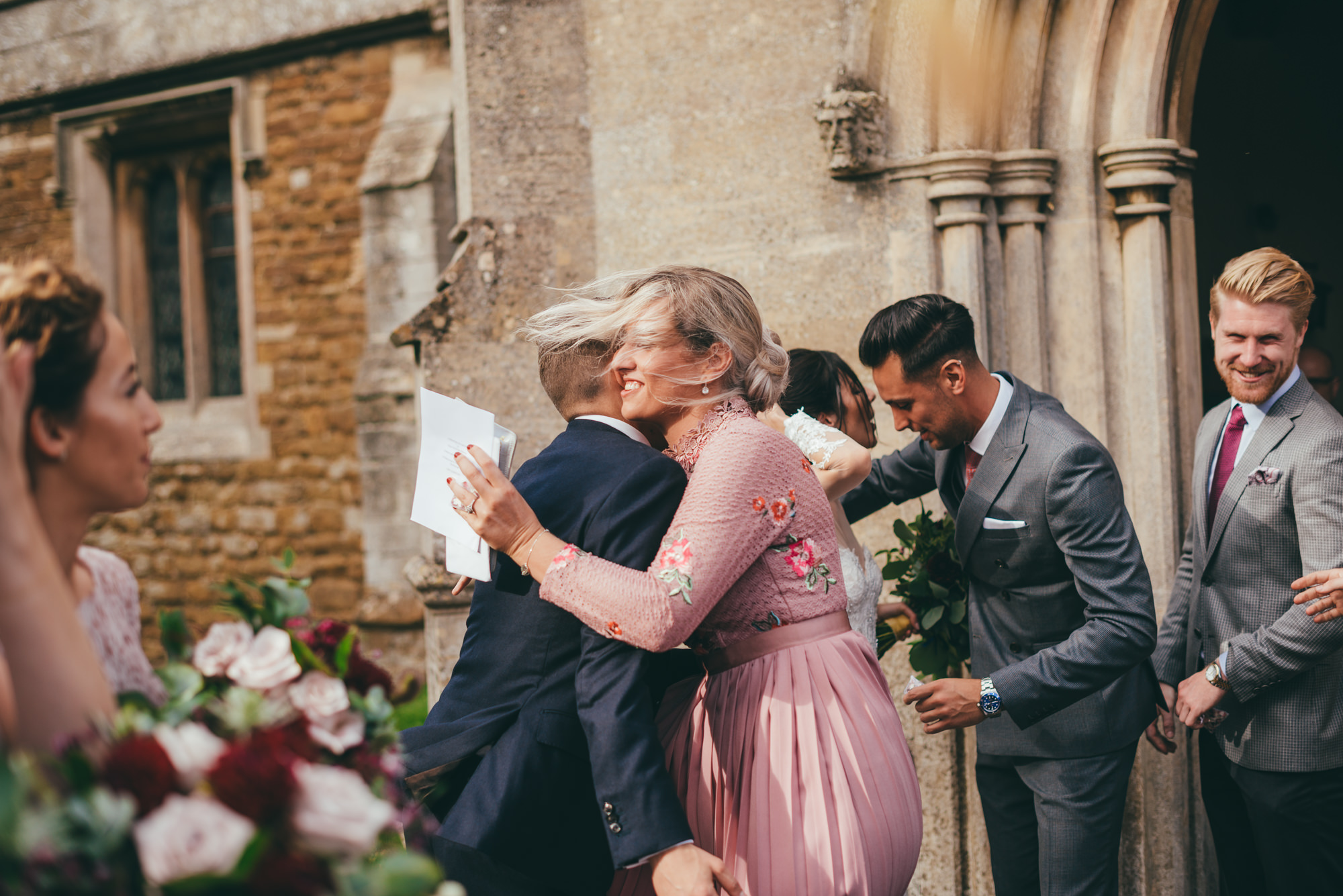 guests hugging after the wedding ceremony