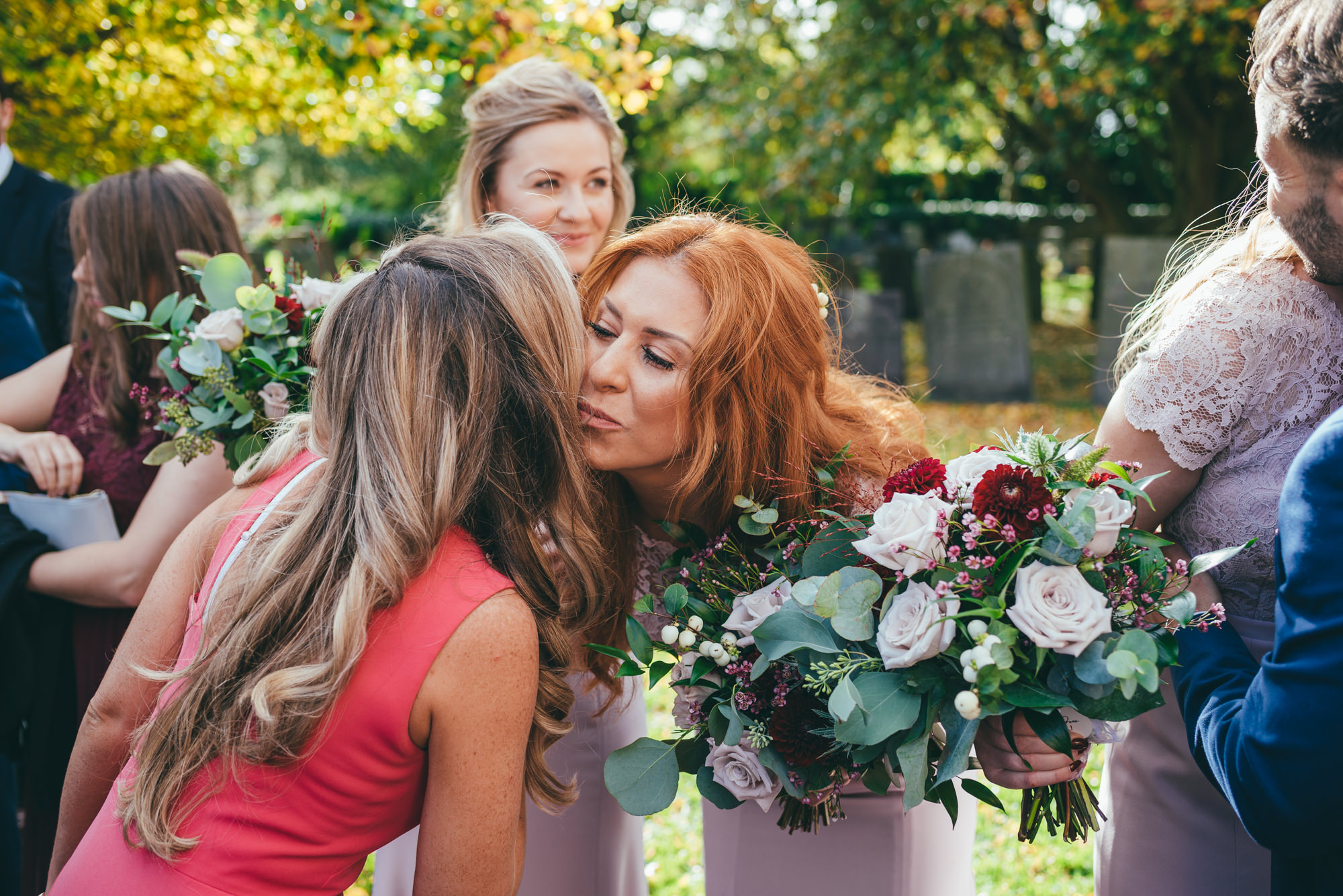 bridesmaid kissing her friend