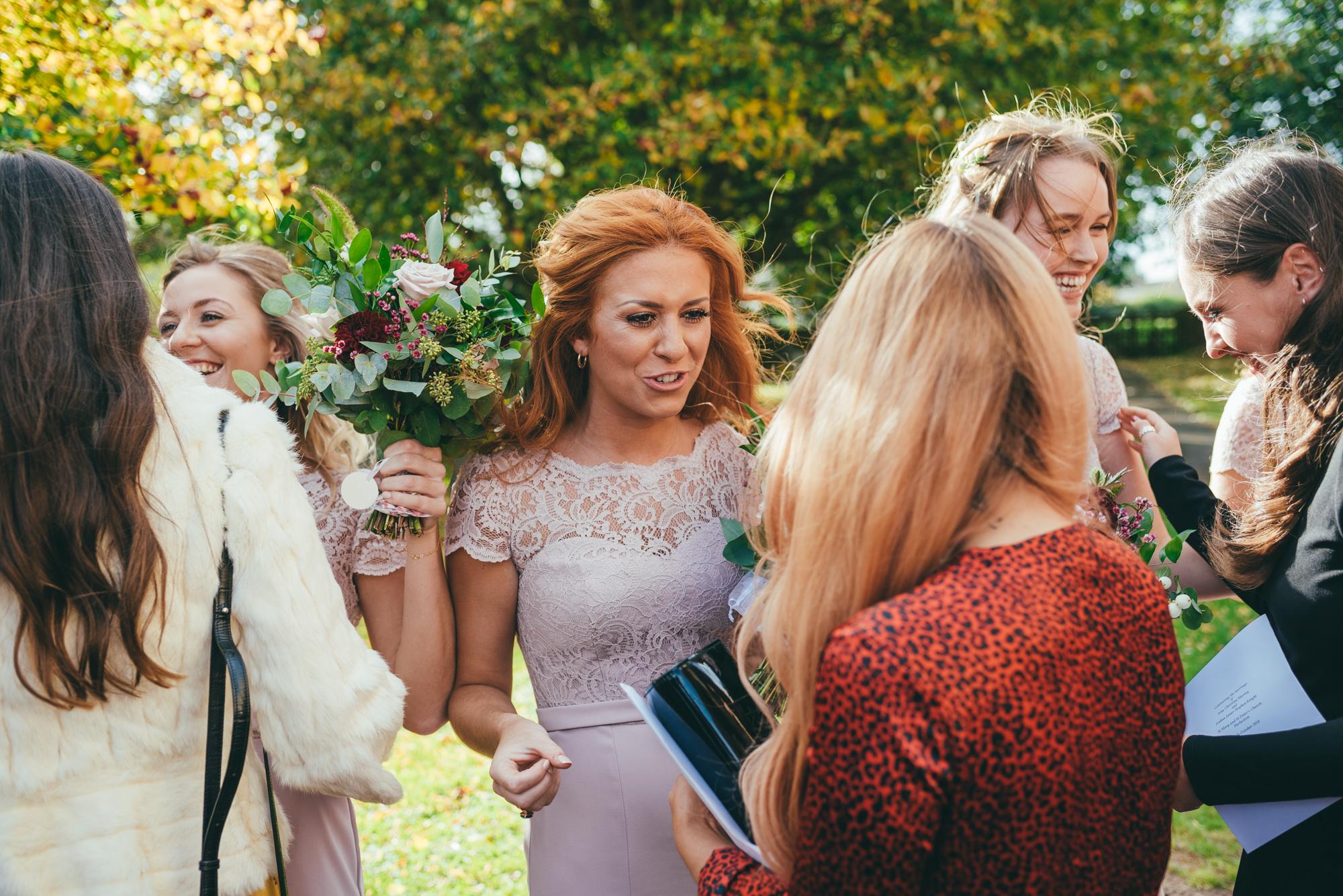 bridesmaid talking to guests