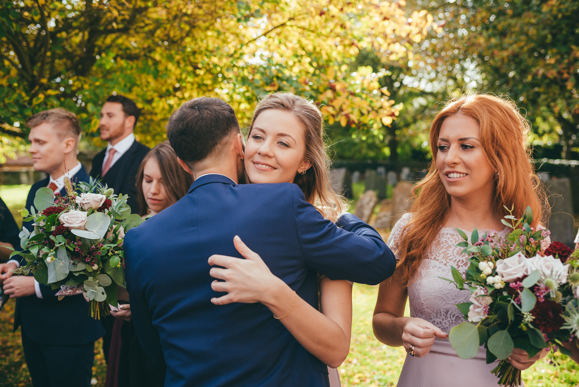bridesmaid hugging her friend
