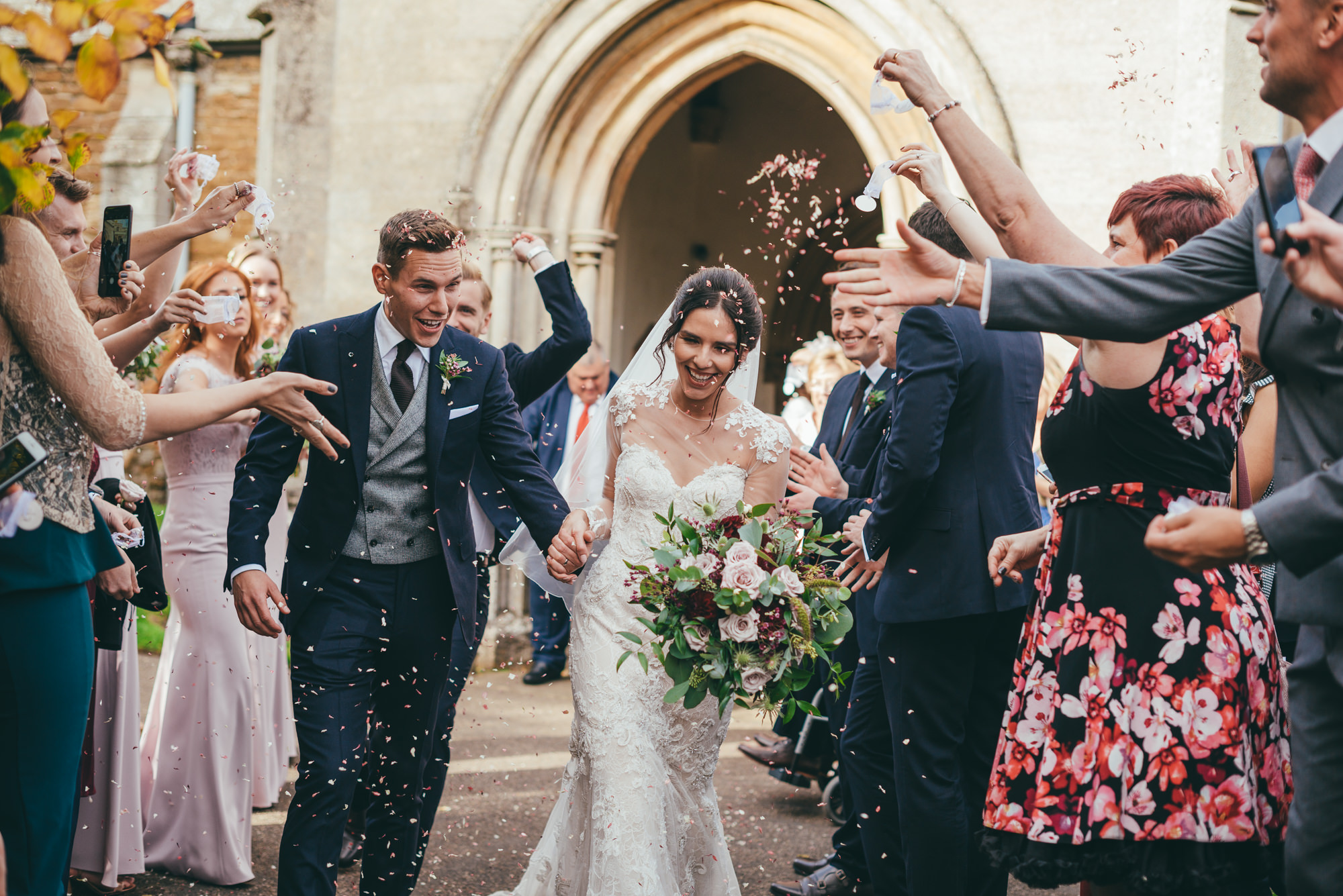 confetti throw over the bride and groom