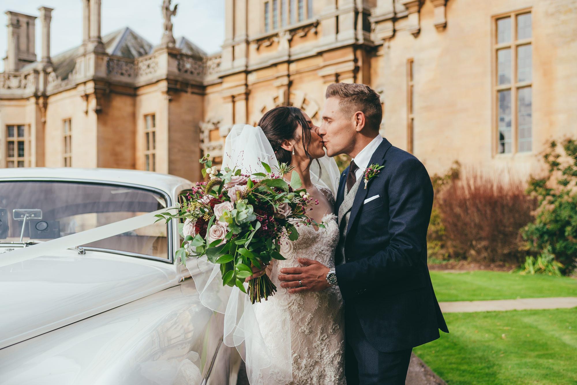 bride and groom kissing at harlaxton manor