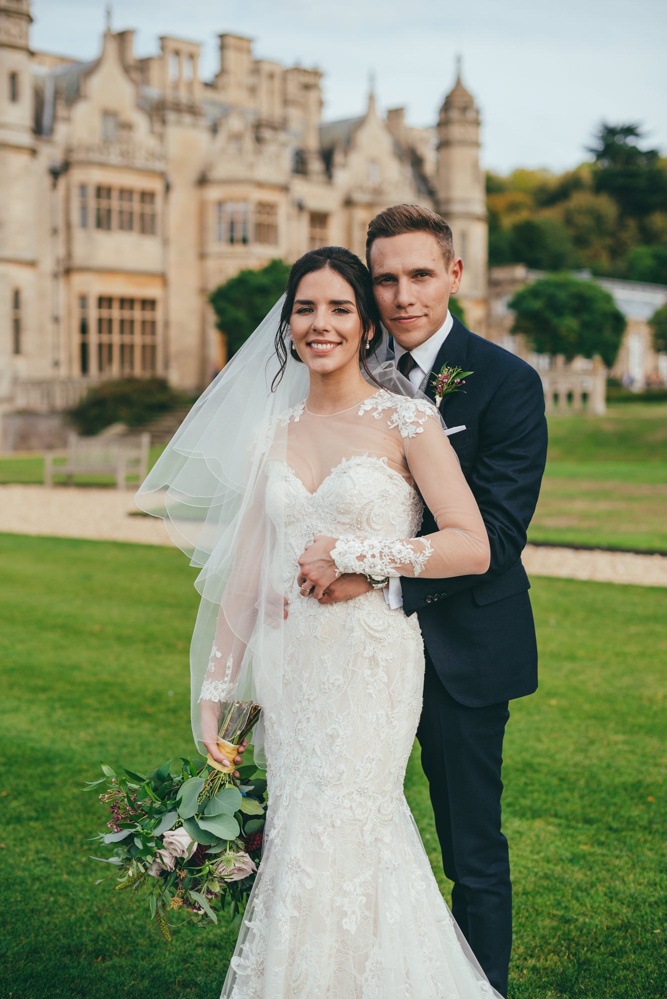 posed picture of the bride and groom at harlaxton manor