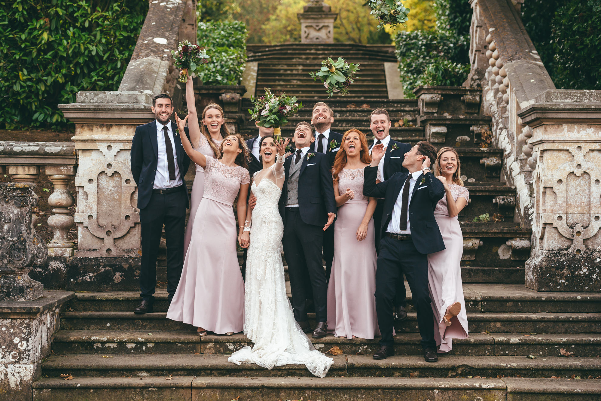 bridal party on the steps at harlaxton manor