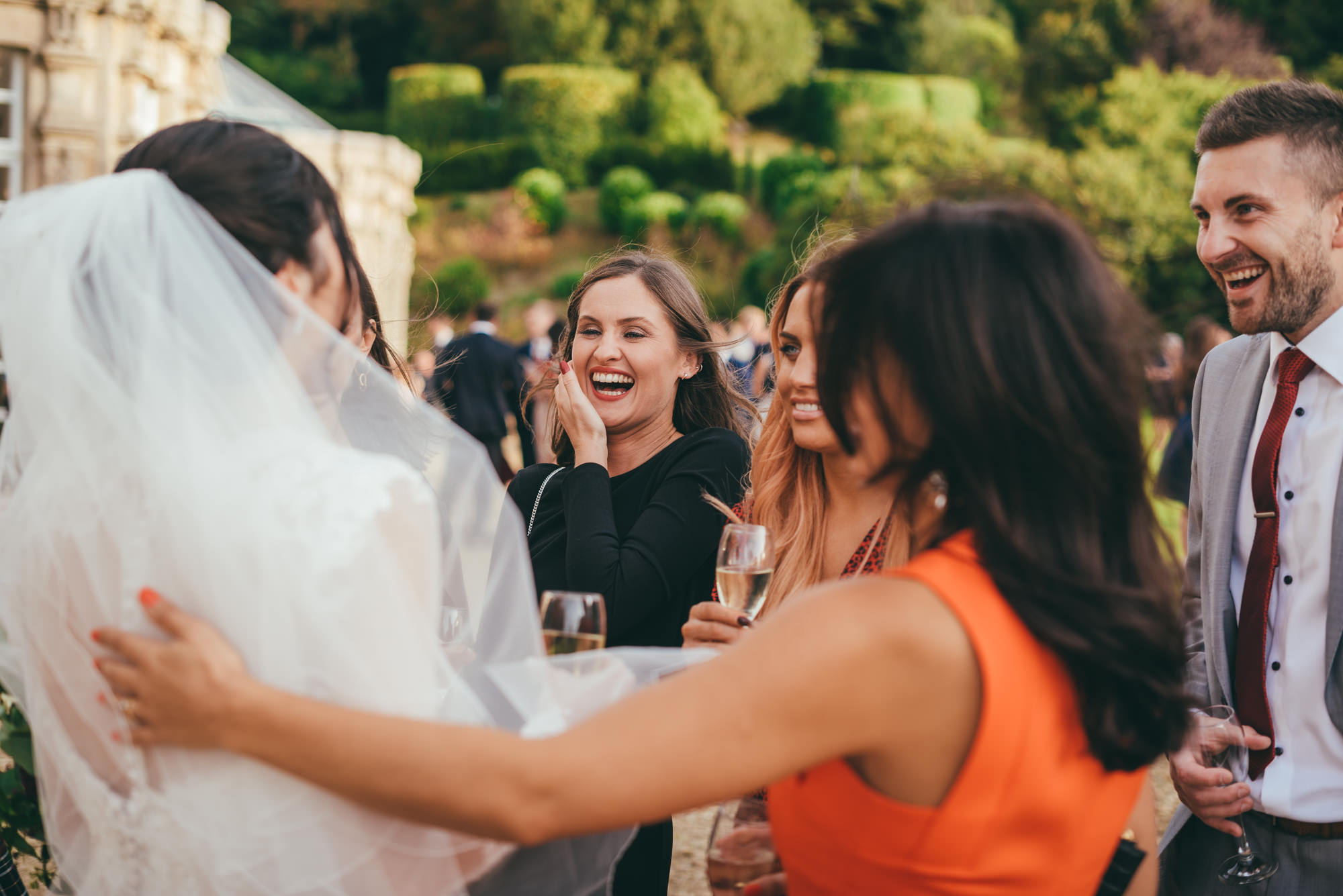 bride laughing with guests