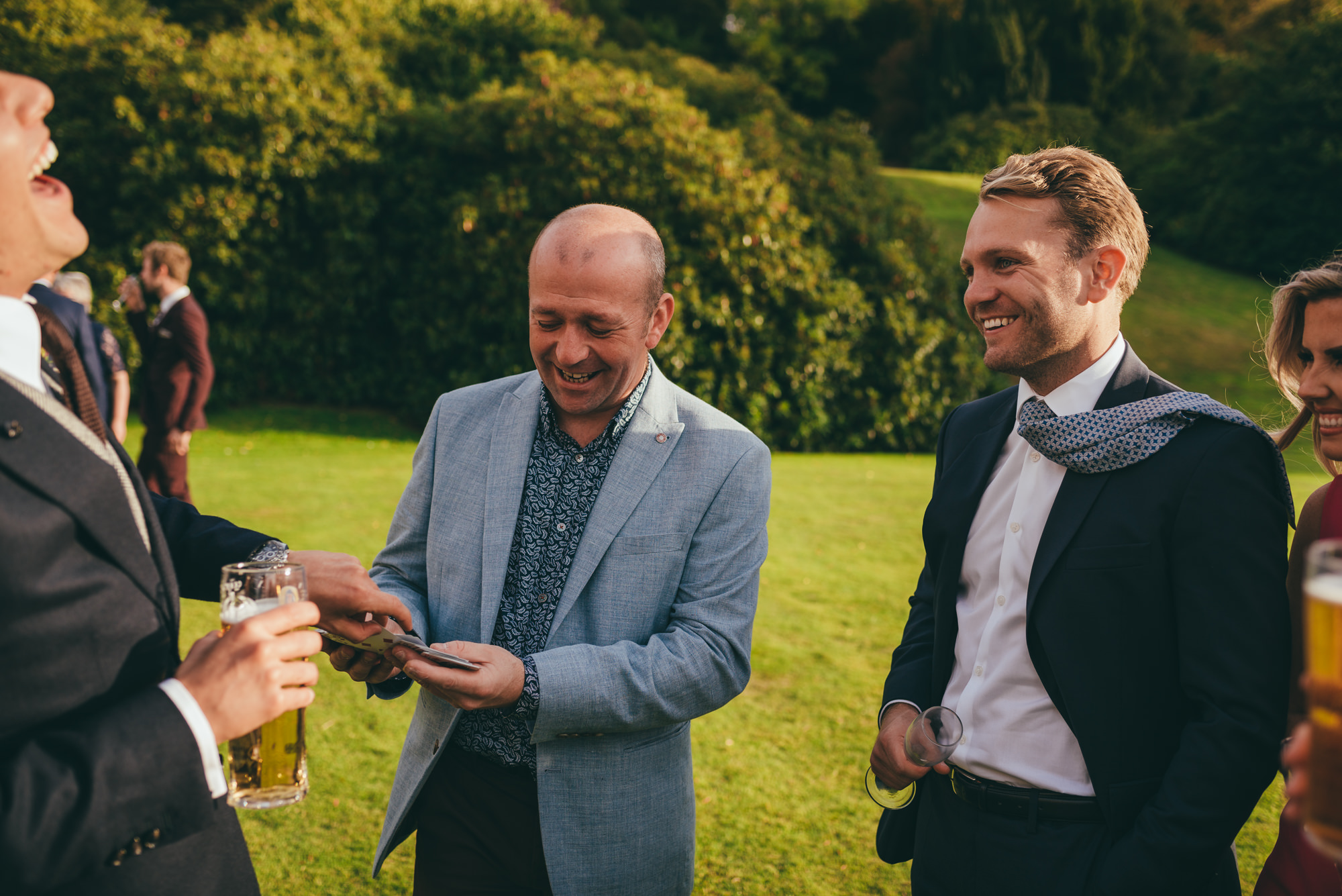 magician doing card tricks with the groom