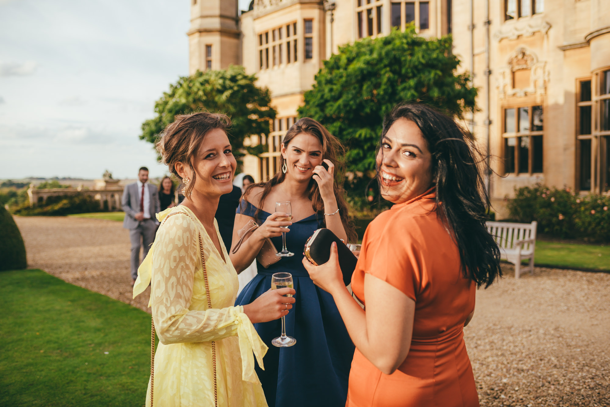 female wedding guests smiling