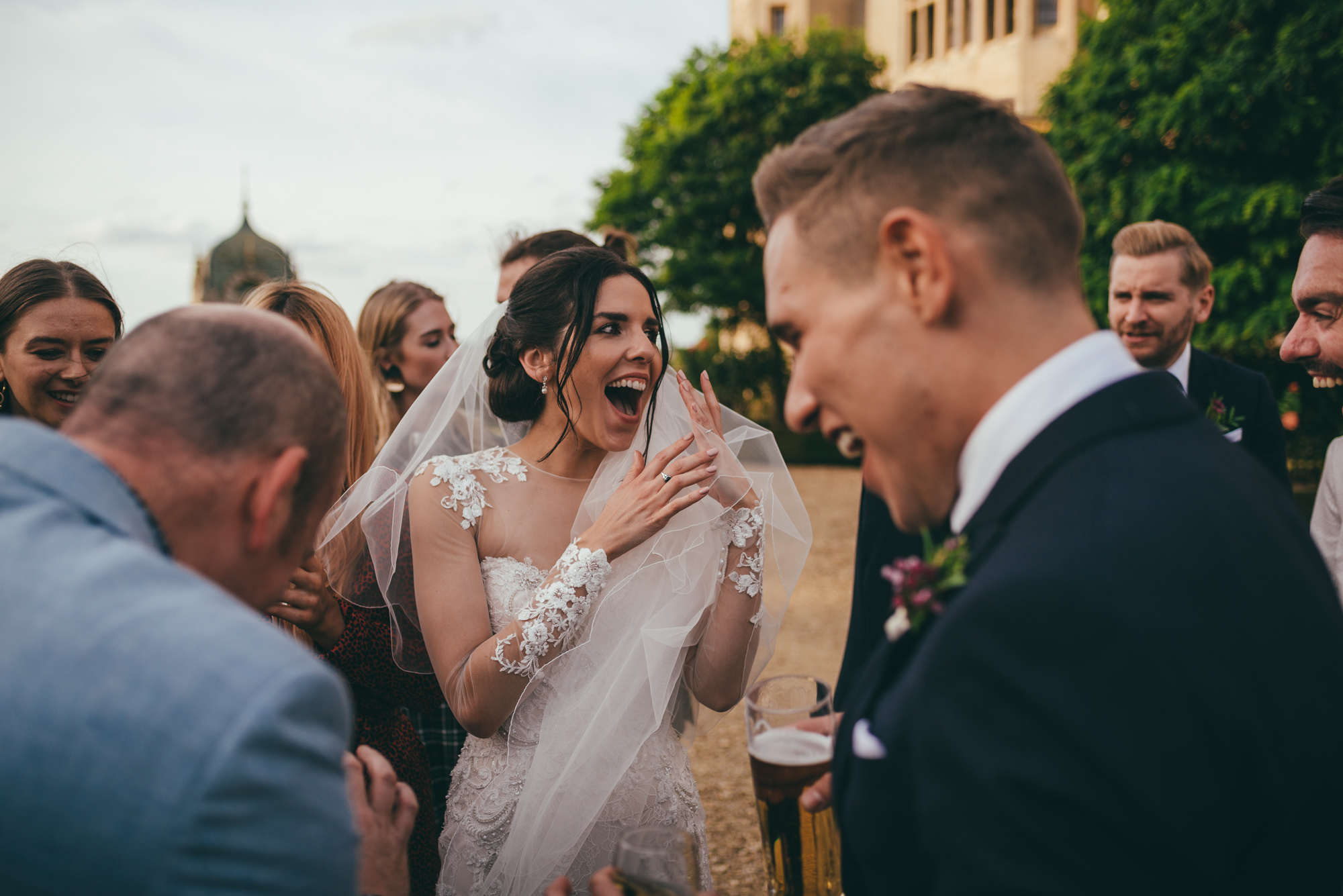 bride and groom amazed at card tricks with the magician