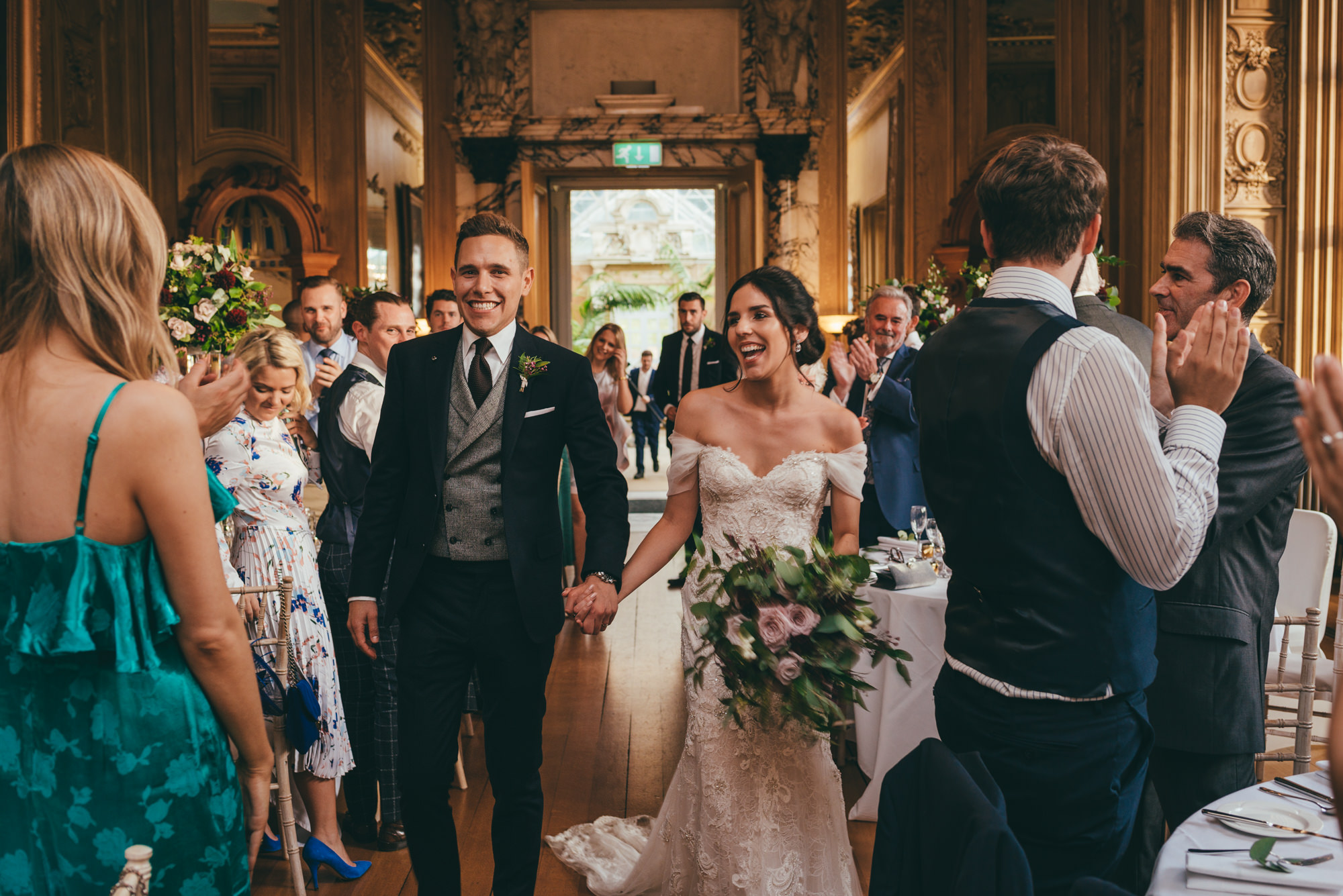 bride and groom are called into the reception room at harlaxton manor