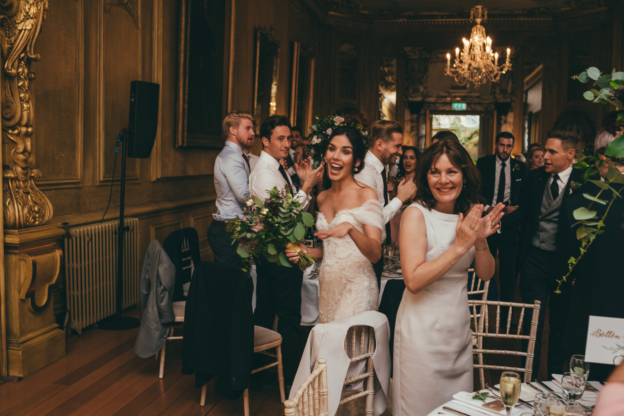 wedding guests cheer in the bride and groom