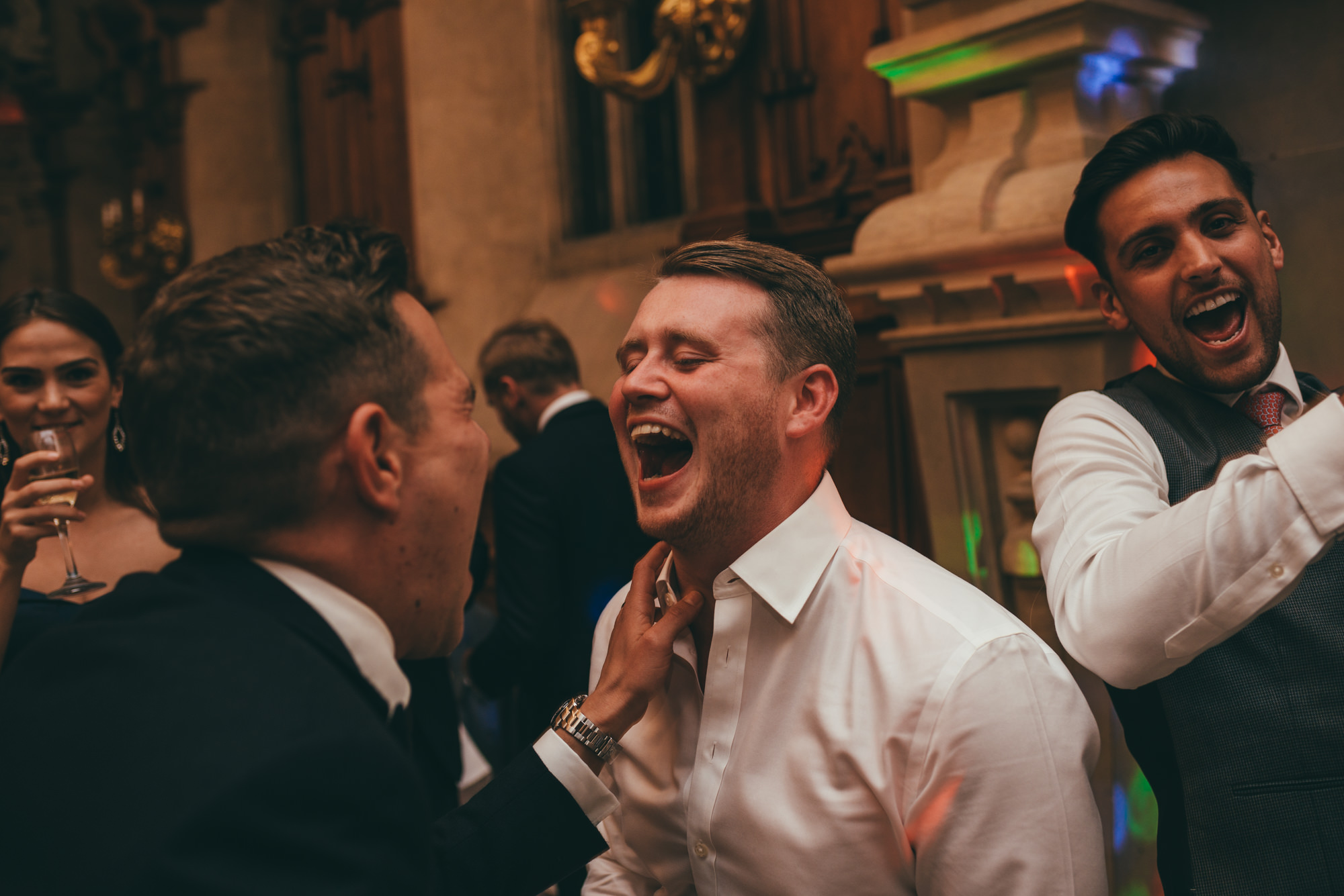 groom and his friends dancing
