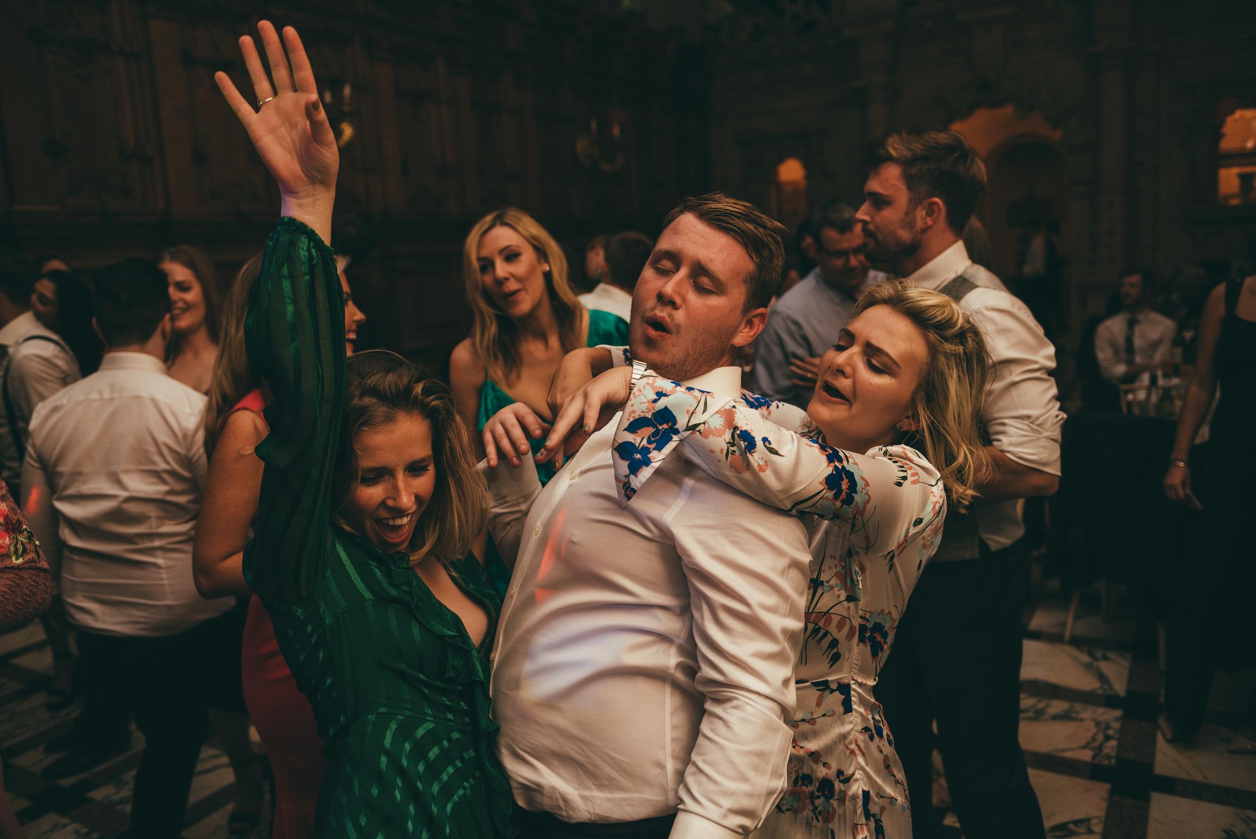 wedding guests dancing at harlaxton manor