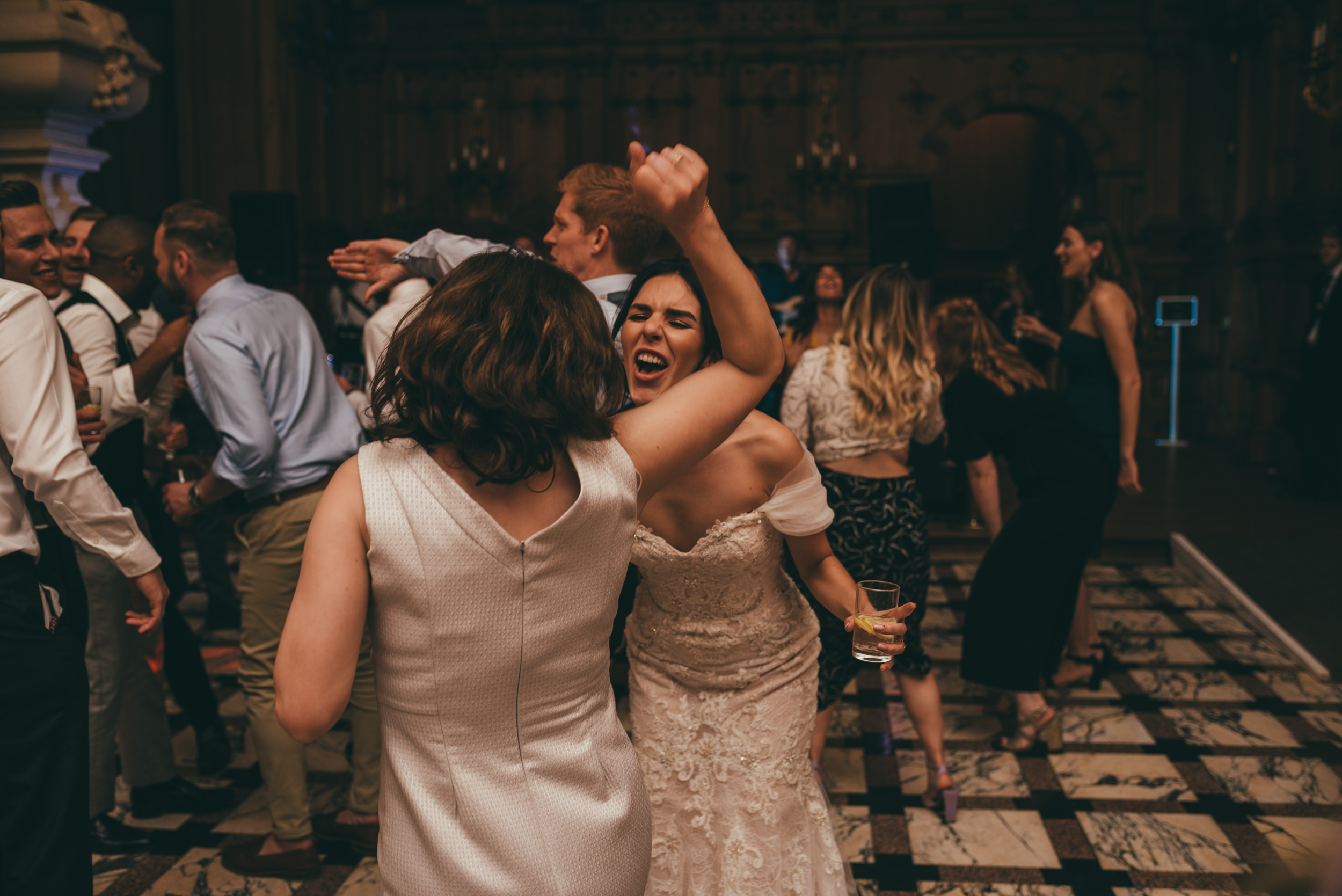 bride and her other dancing at harlaxton manor