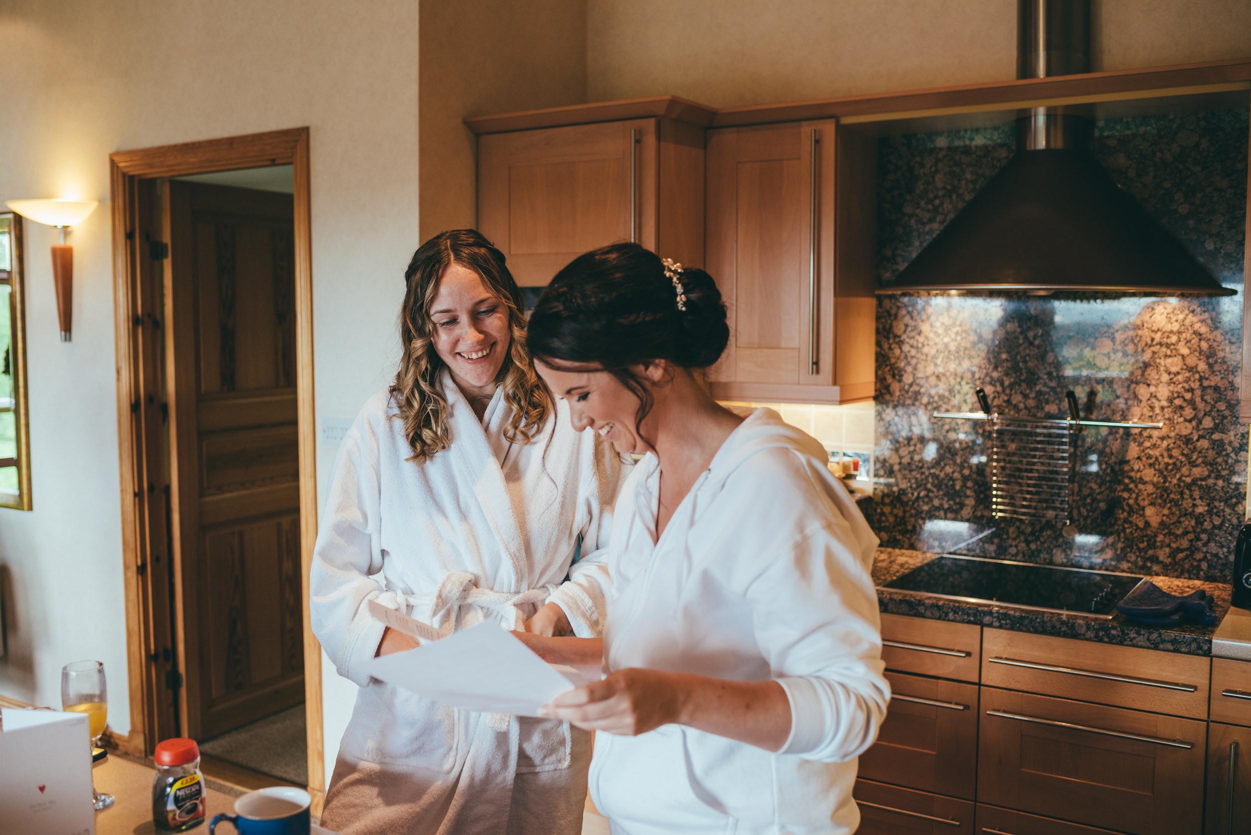 Bride and bridesmaid sharing a joke at Belton Woods Hotel