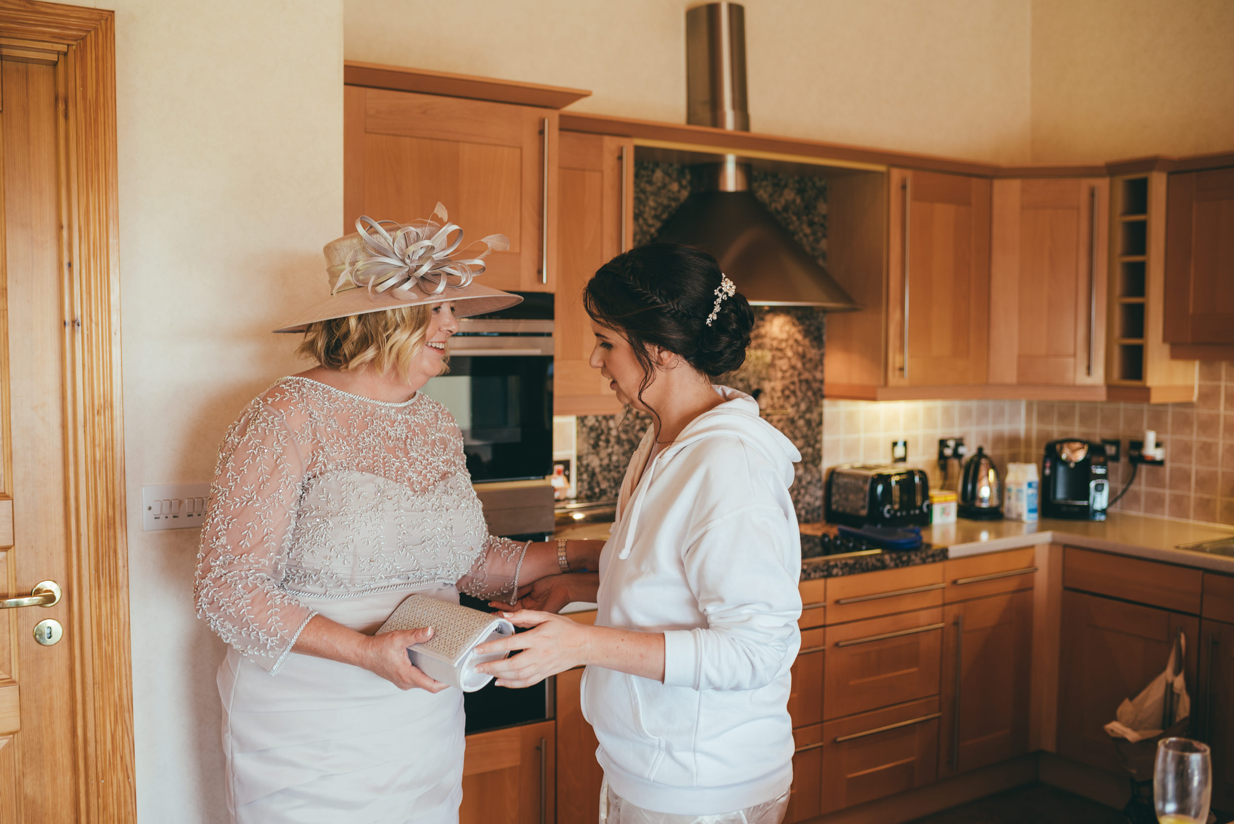Bride and her mother talking at Belton Woods Hotel