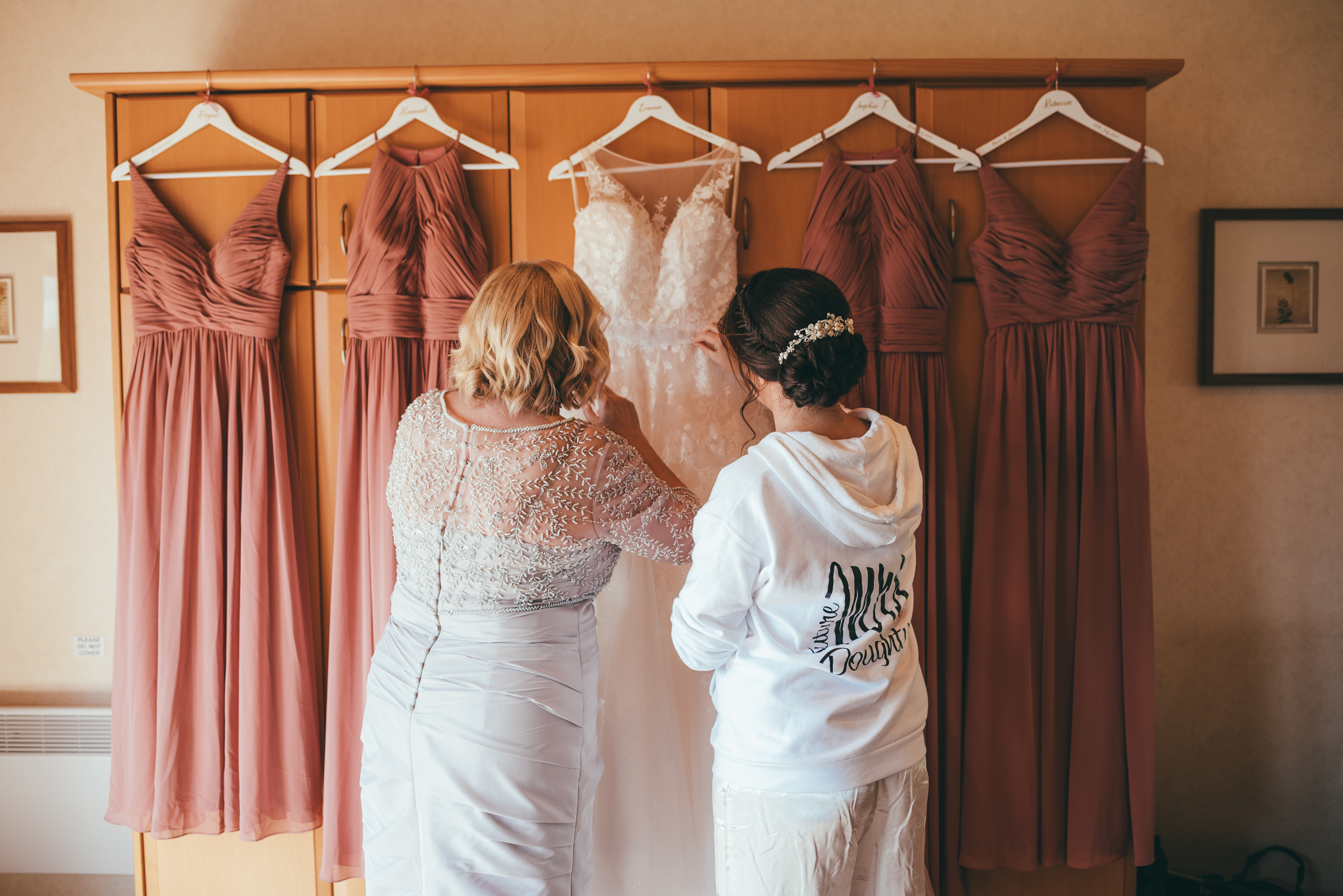 Bride and her mother looking at the wedding dress at Belton Woods Hotel