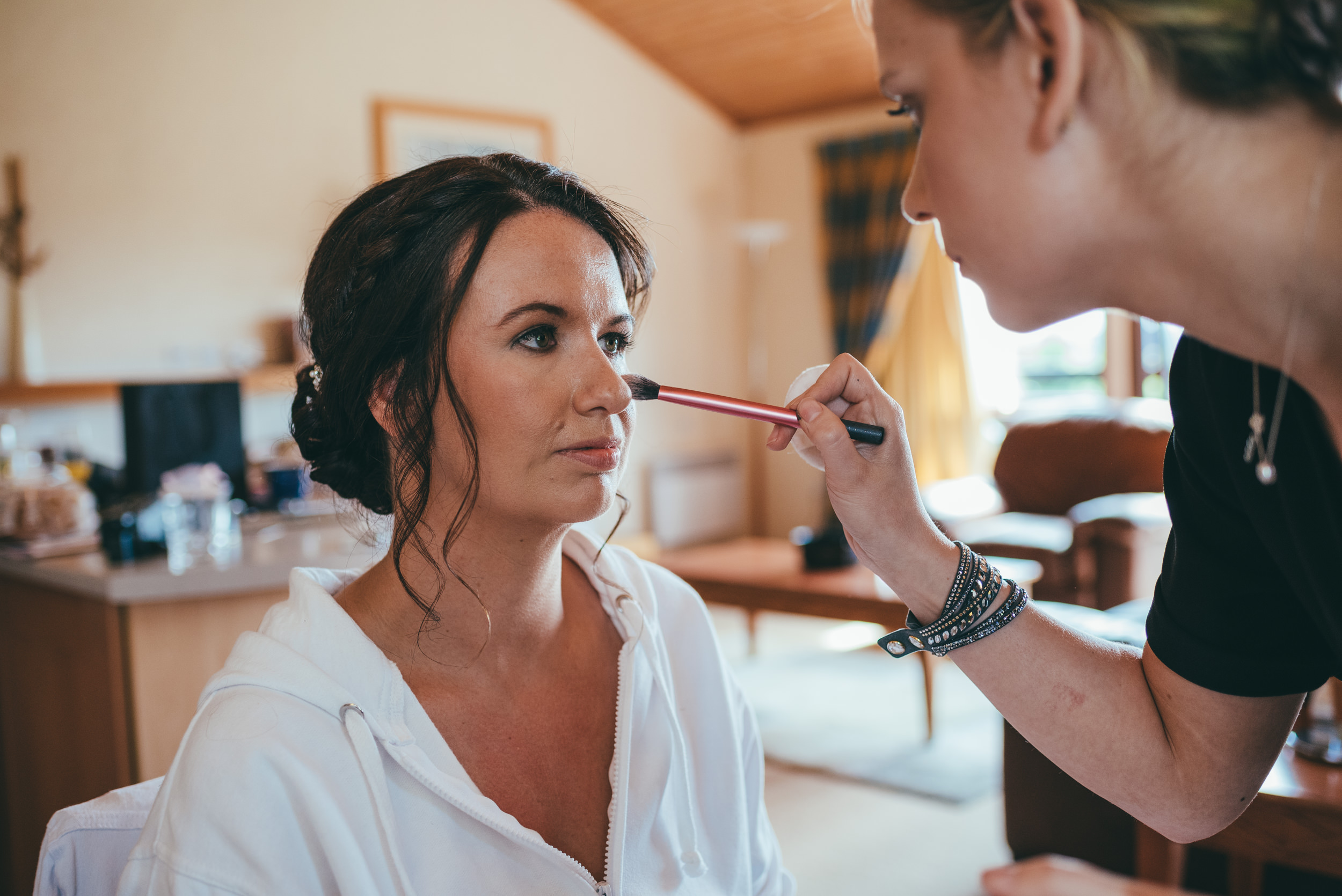 Bride having her makeup touched up at Belton Woods Hotel