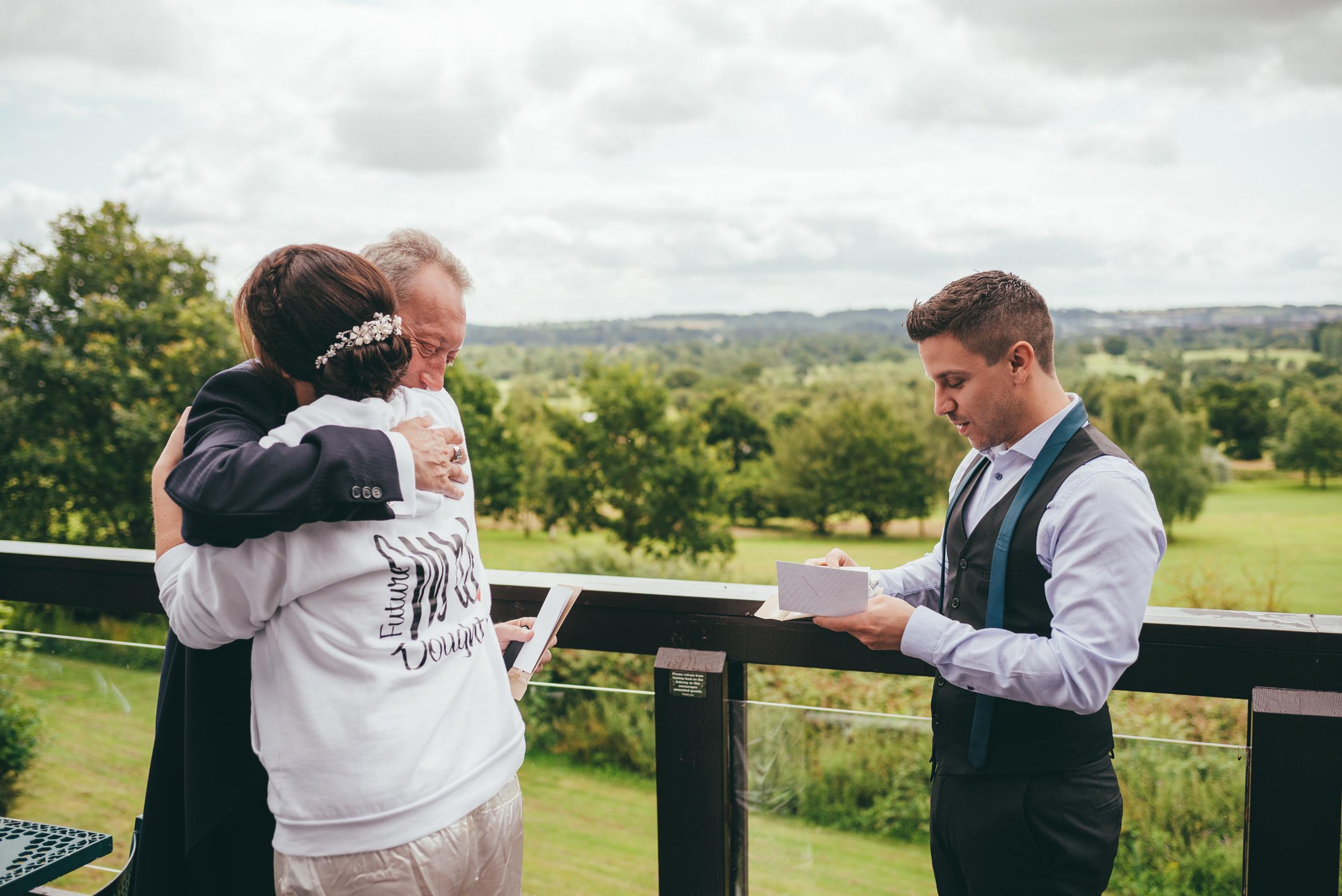 Bride hugging er father at Belton Woods Hotel