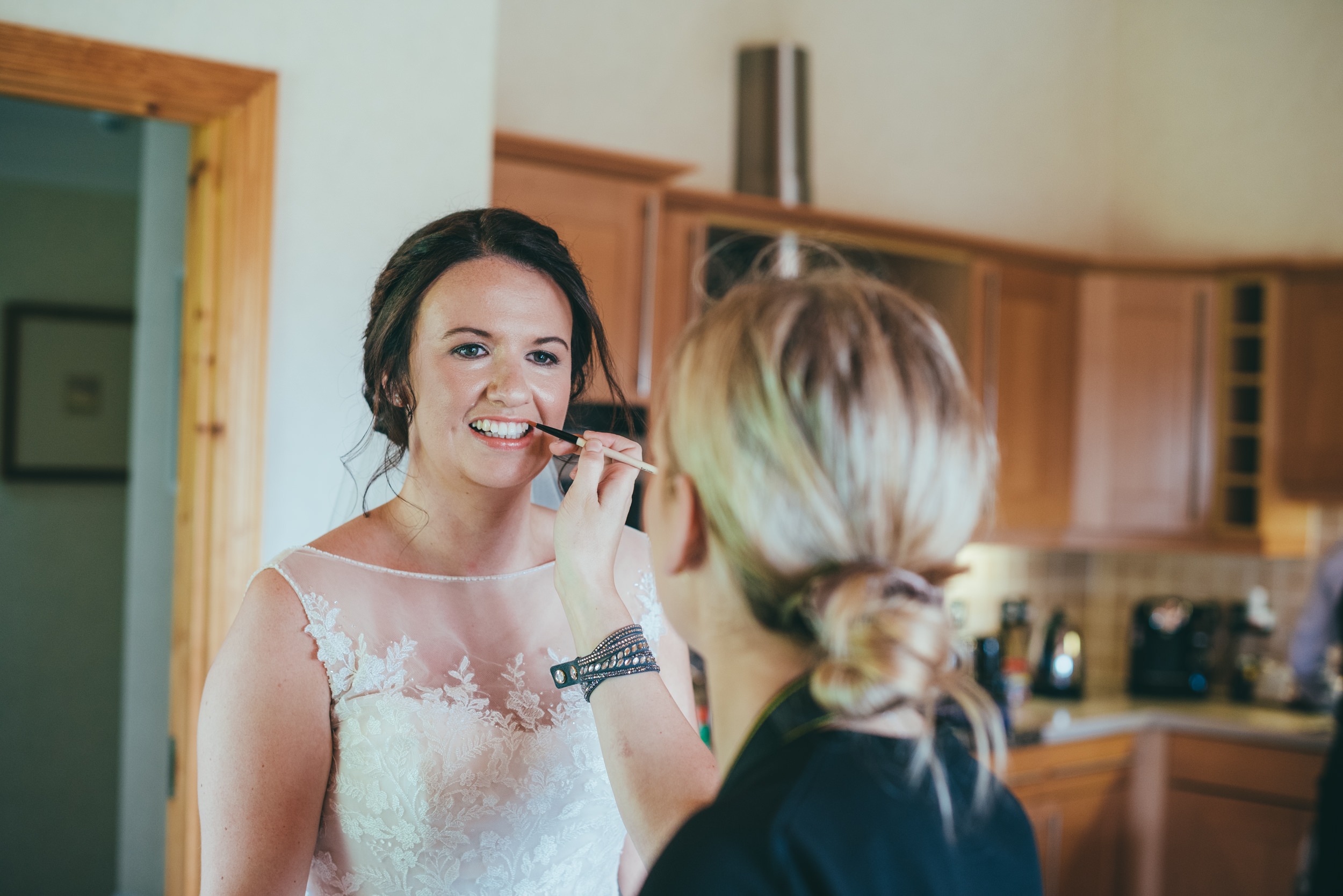 bride having her make up touched up