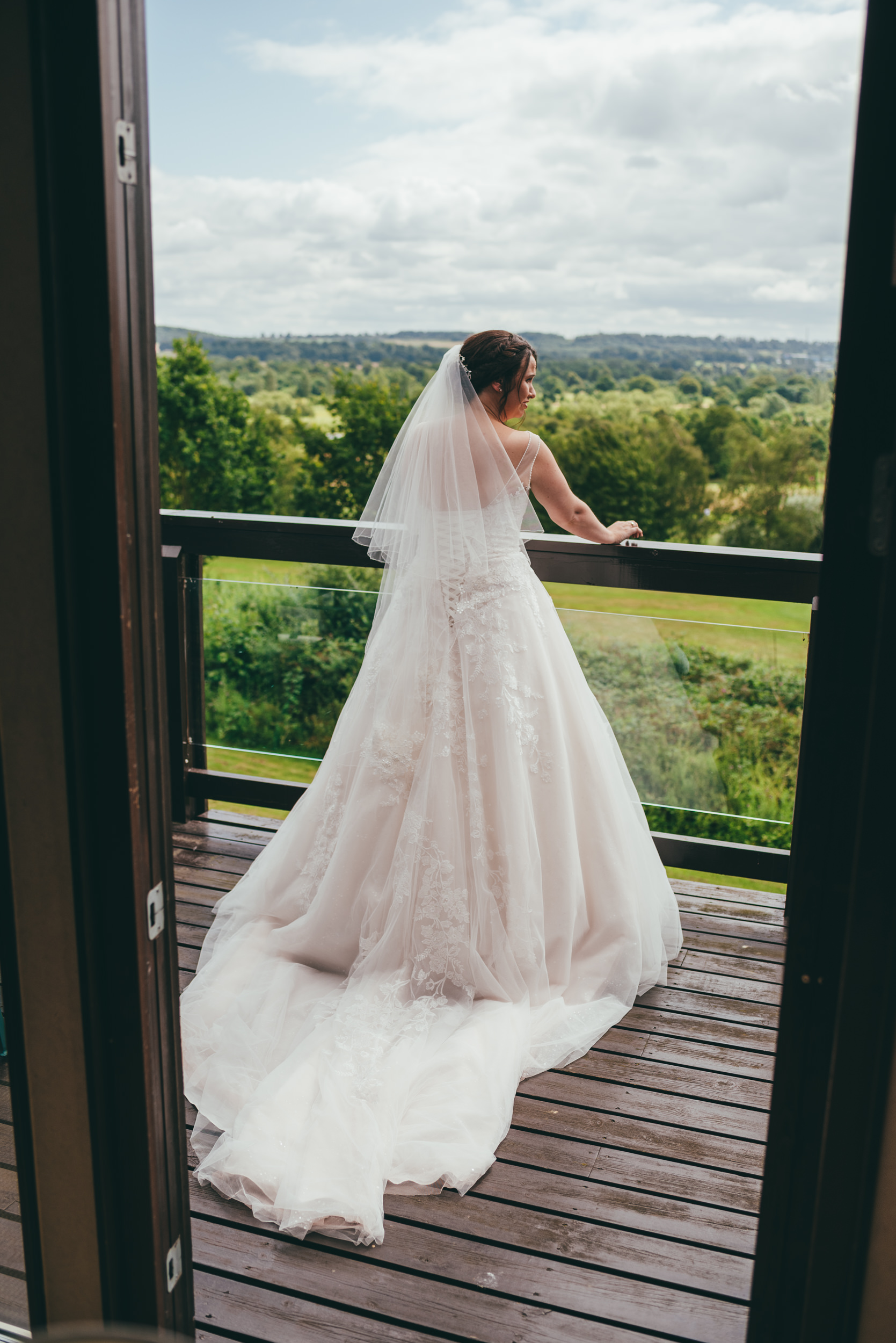 bride in her dress on the balcony at Belton Woods hotel