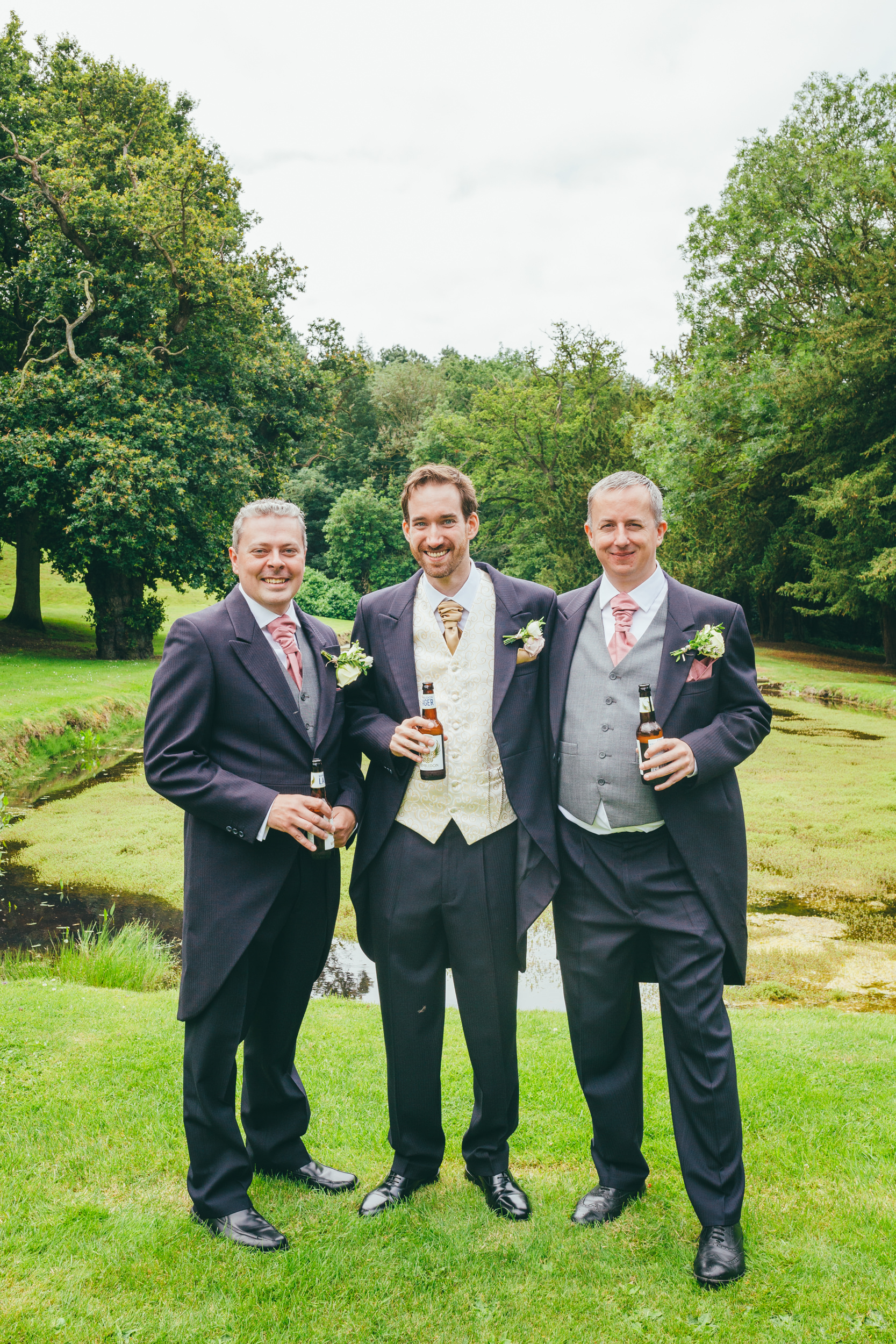 Group photograph of the groom and his bestmen at Harlaxton Manor