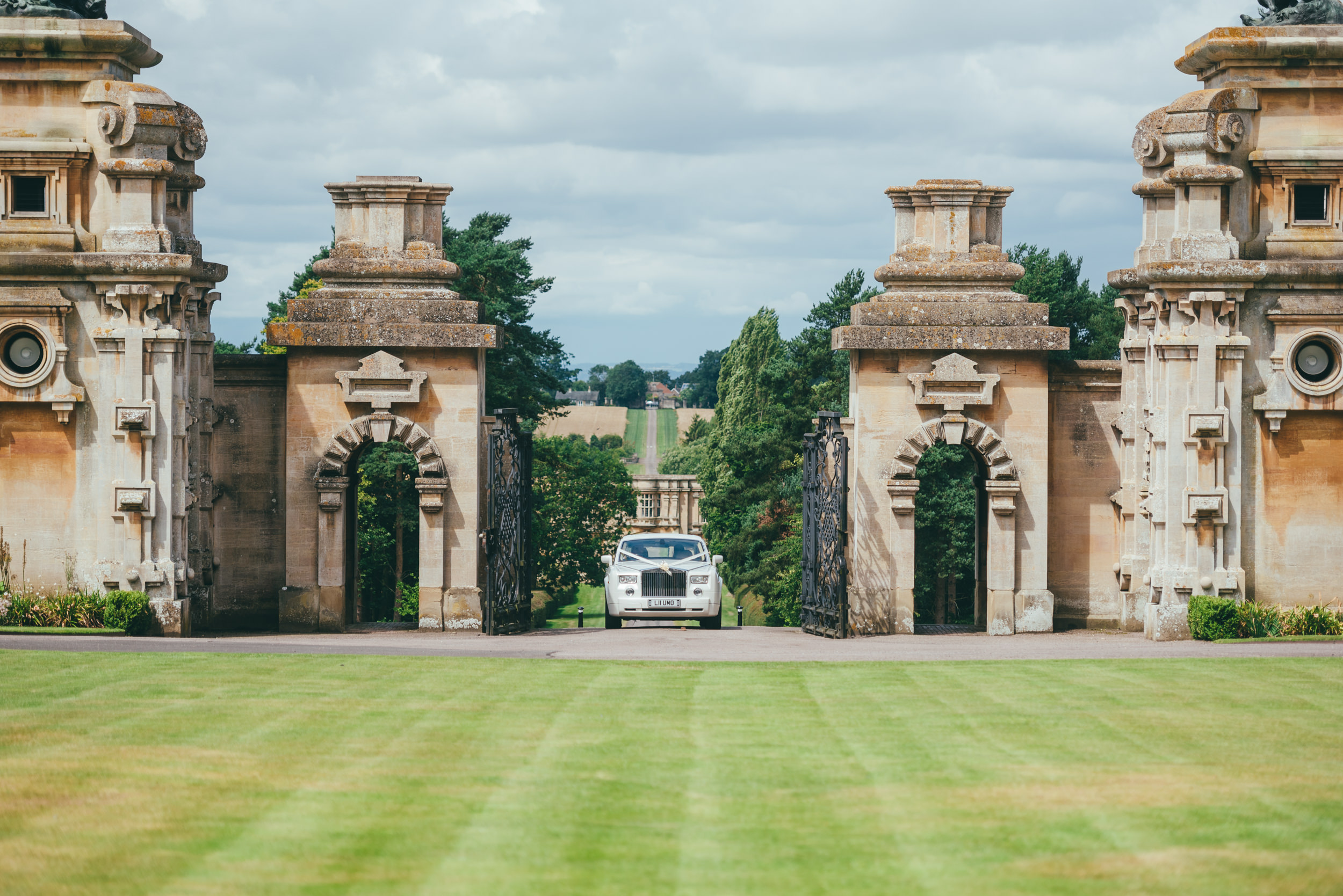 The bride arriving at Harlaxton Manor for her wedding