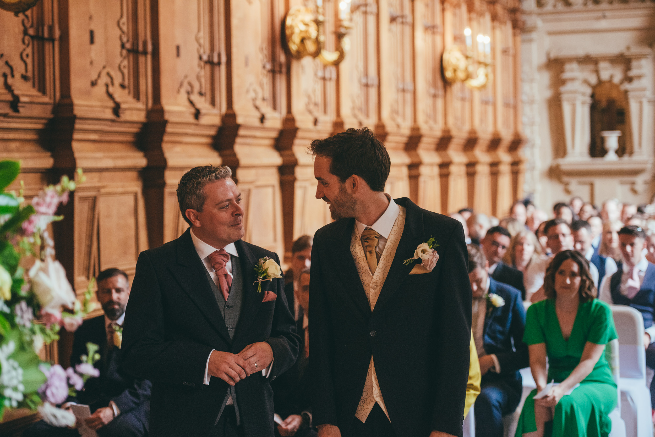 Groom and bestman share a joke while waiting for the bride to arrive at Harlaxton Manor