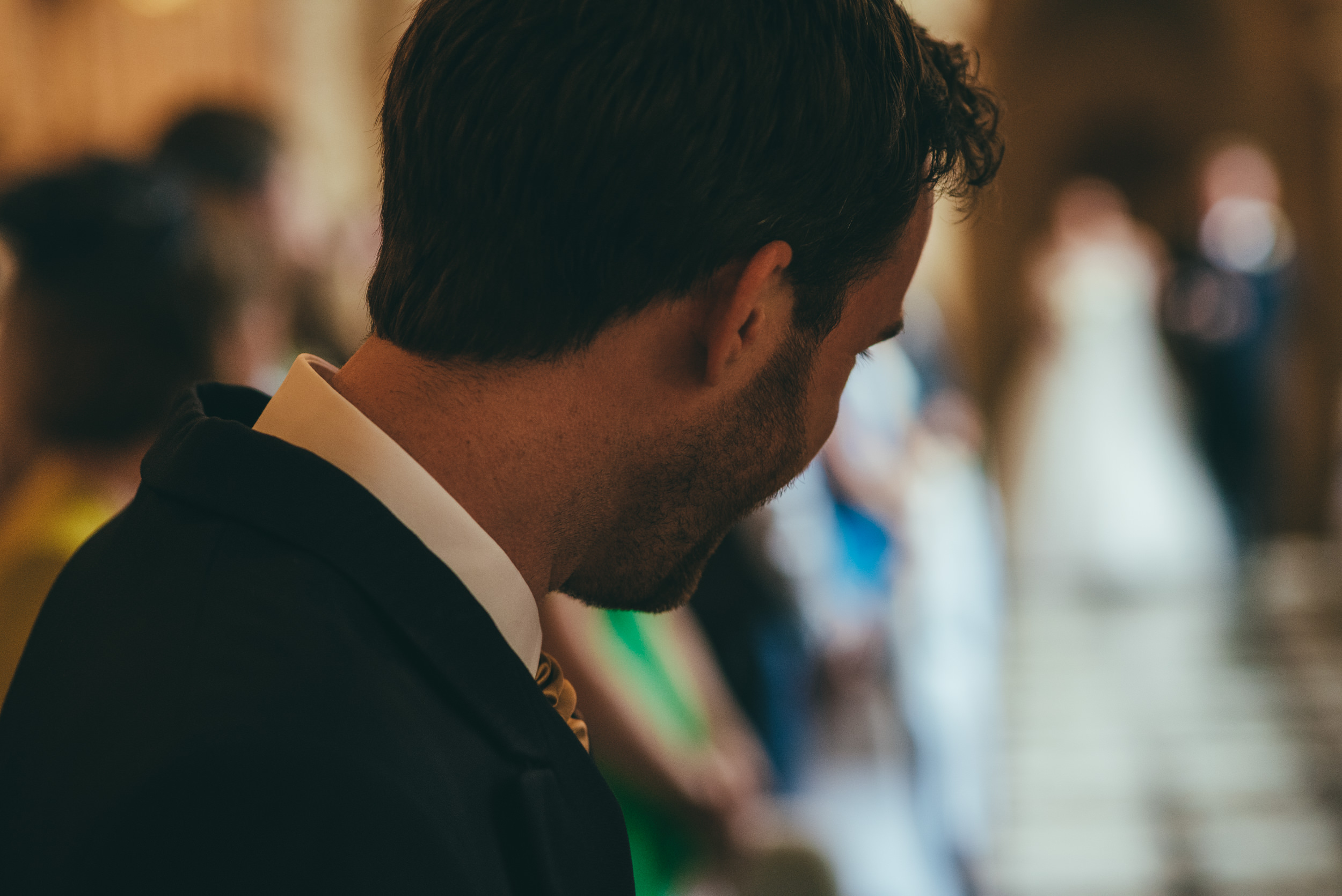 Grooms happy reaction to his bride walking down the aisle at Harlaxton Manor