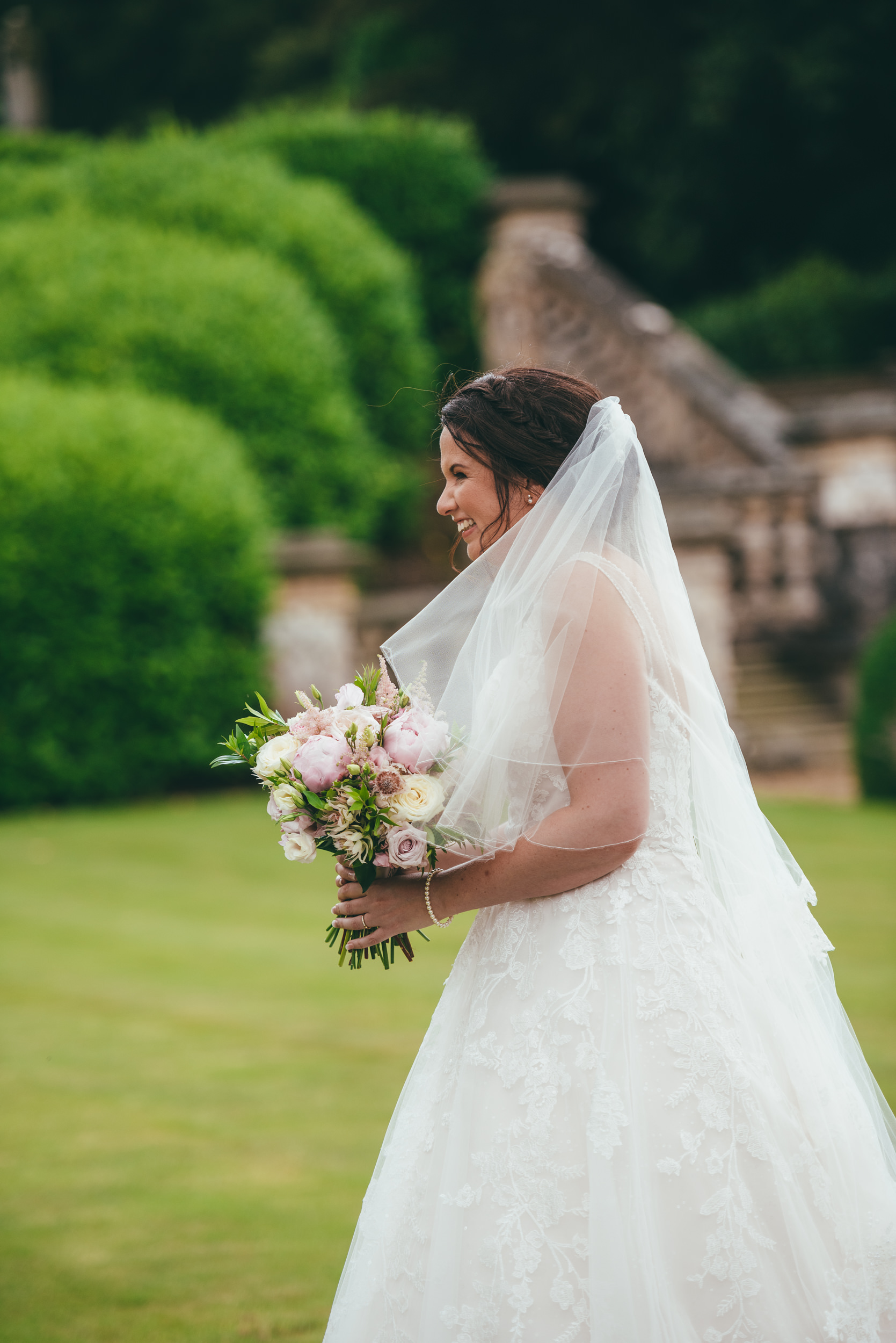 candid photograph of the bride at Harlaxton Manor