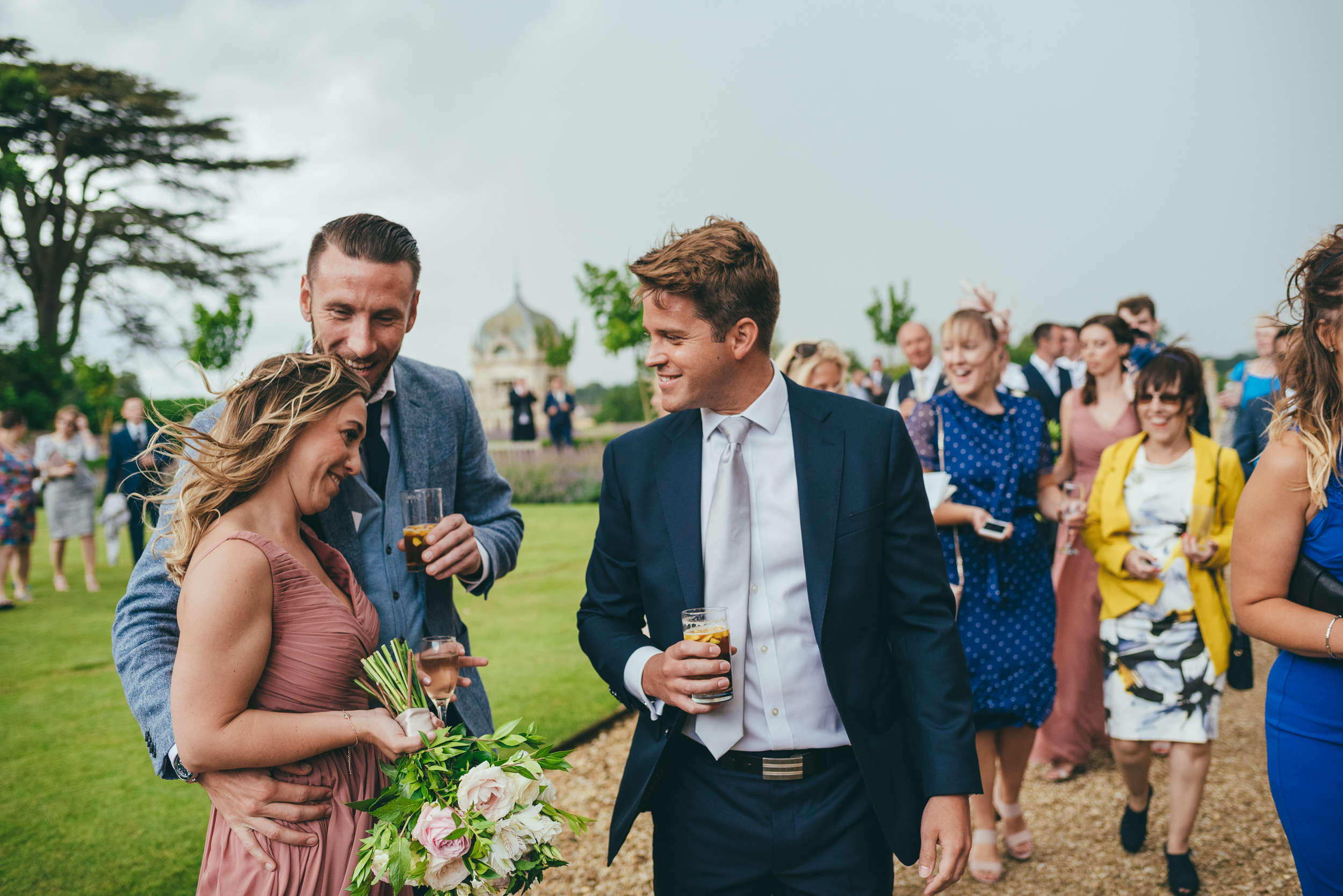 wedding guests talking at Harlaxton Manor