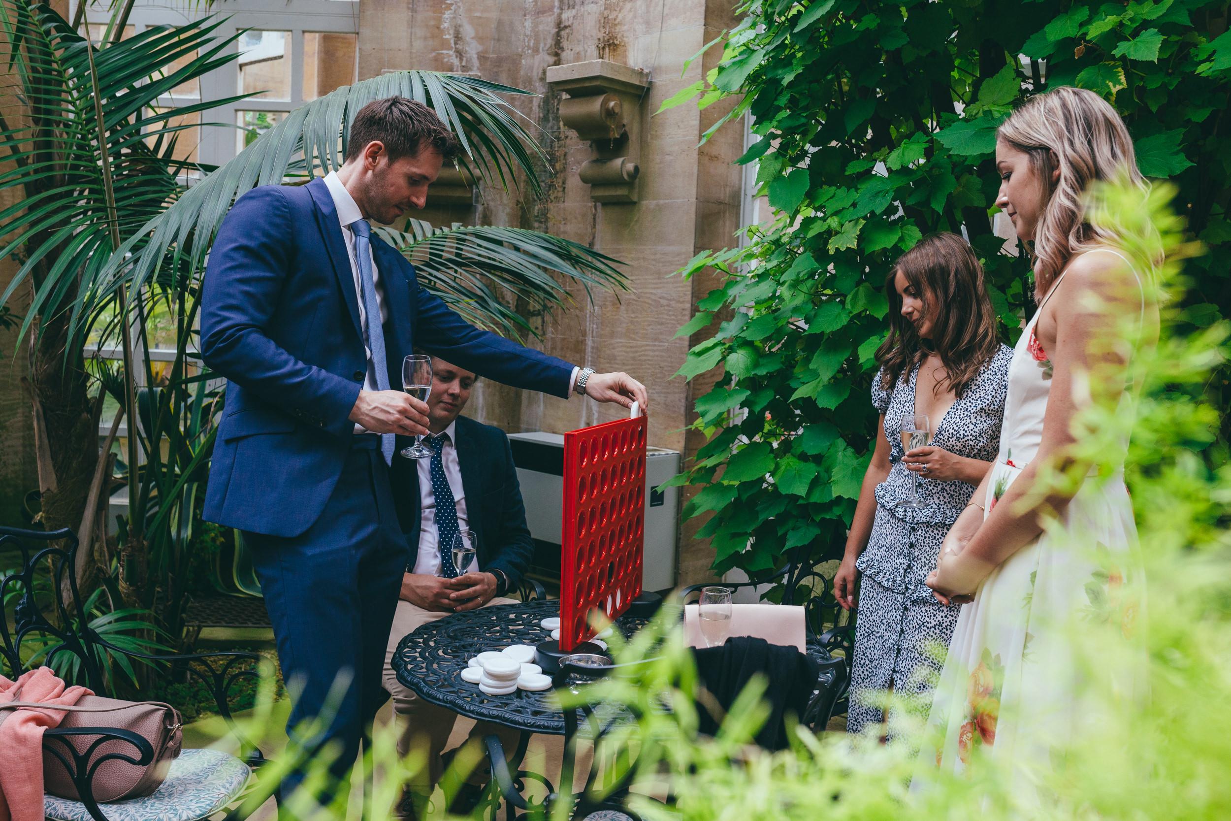 Wedding guests playing games at a wedding at Harlaxton Manor