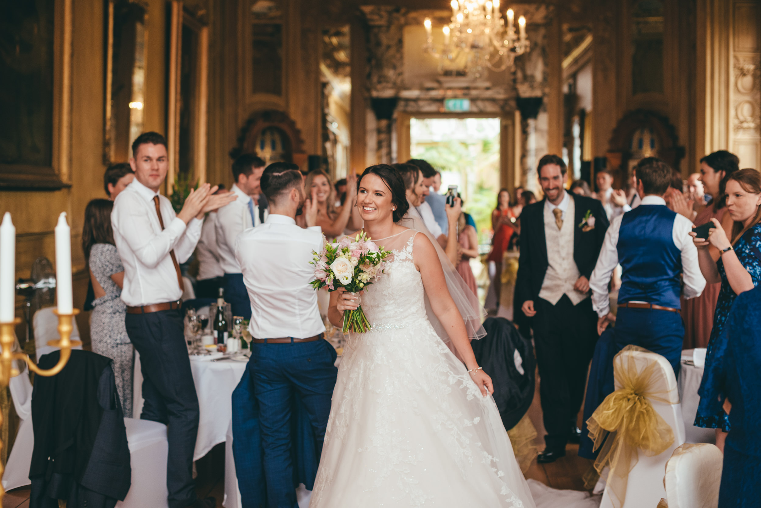 Bride and groom entering the reception room at Harlaxton manor