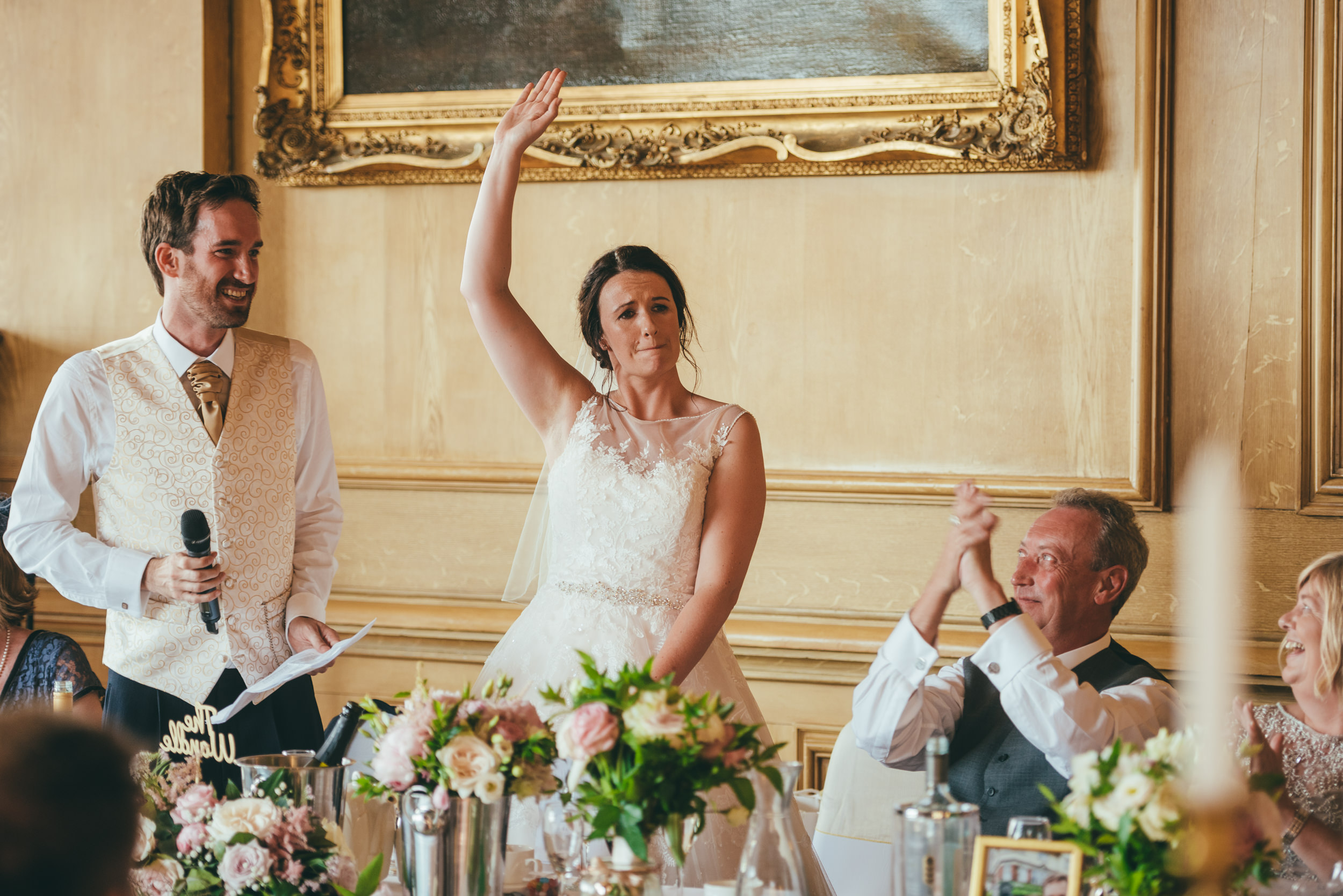 Bride and grrom making a speech on their wedding day at Harlaxton Manor