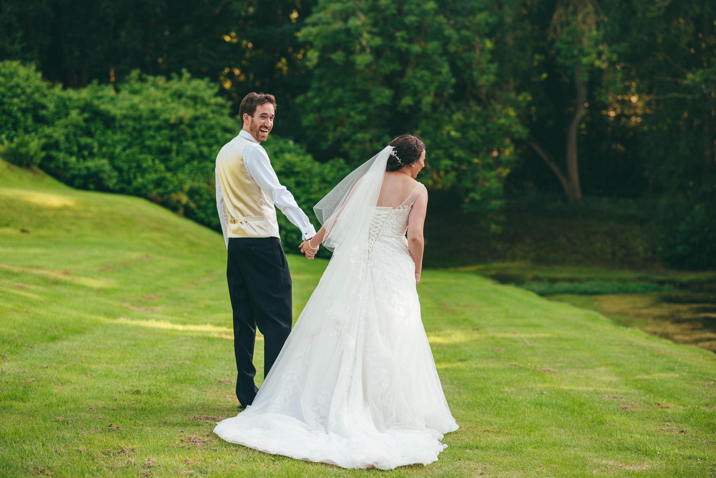 Bride and groom sharing a joke
