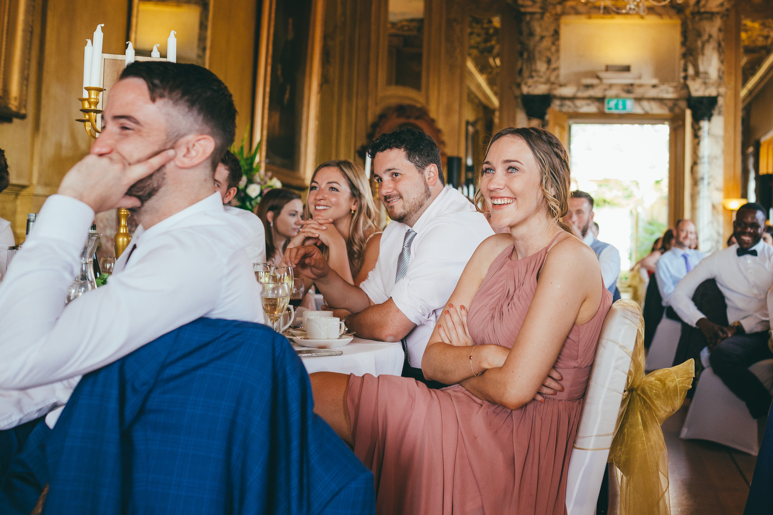 Wedding guests enjoying the speeches at Harlaxton Manor