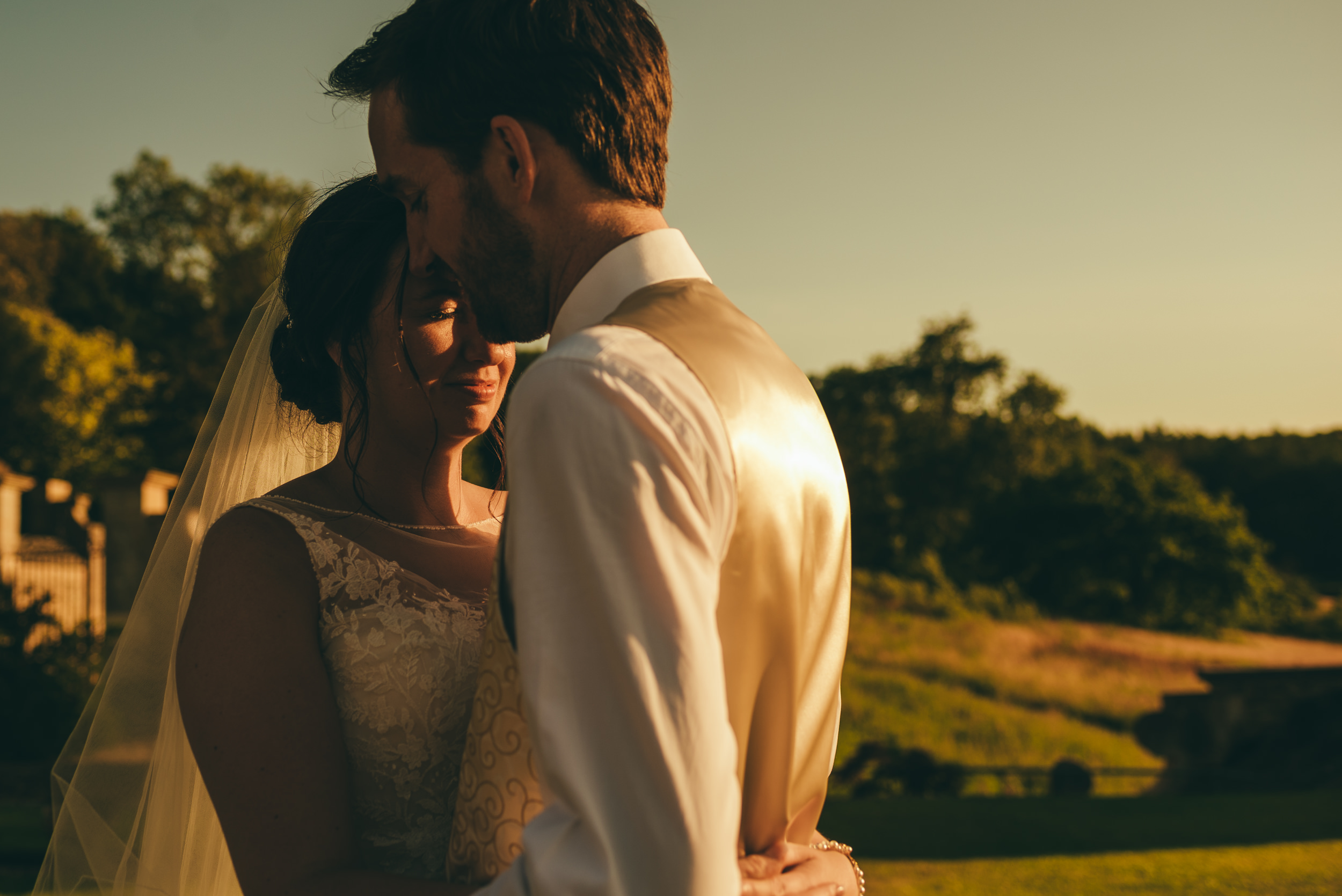 Bride and groom at sunset at Harlaxton Manor