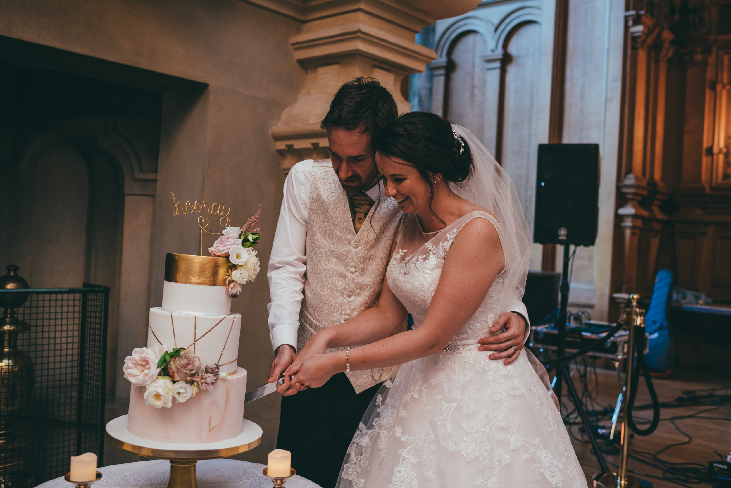 Cake cutting at Harlaxton Manor wedding