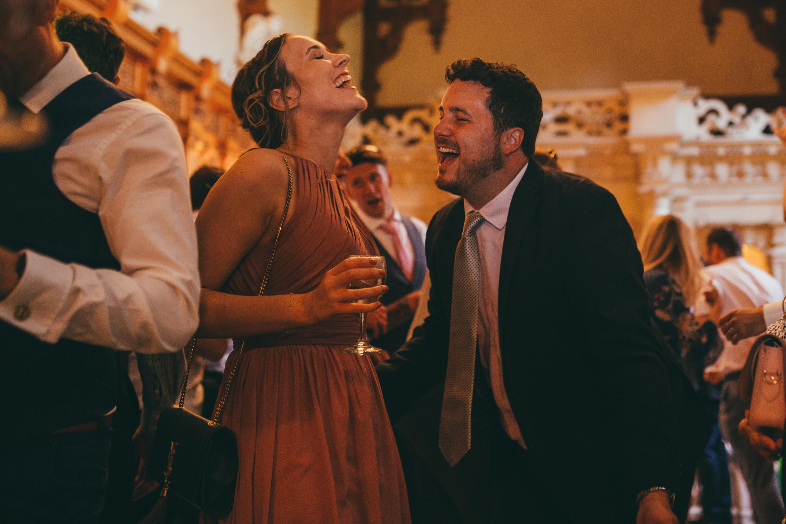 Guests laughing at Harlaxton Manor