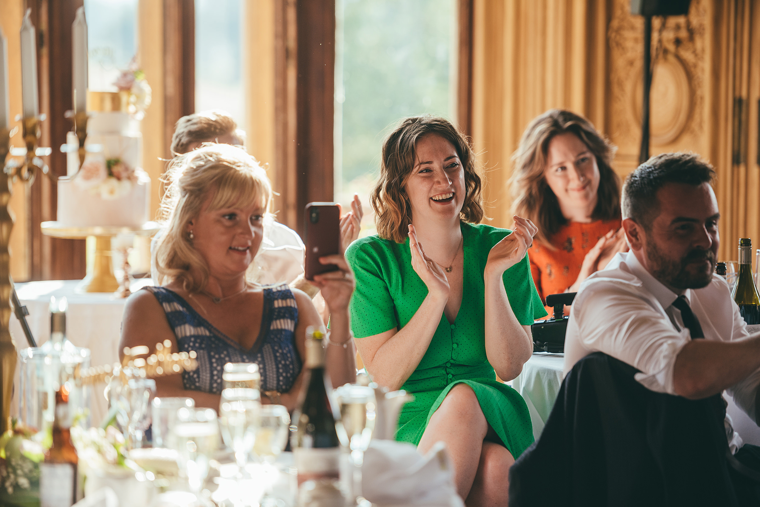 Guests enjoying the speeches at Harlaxton Manor
