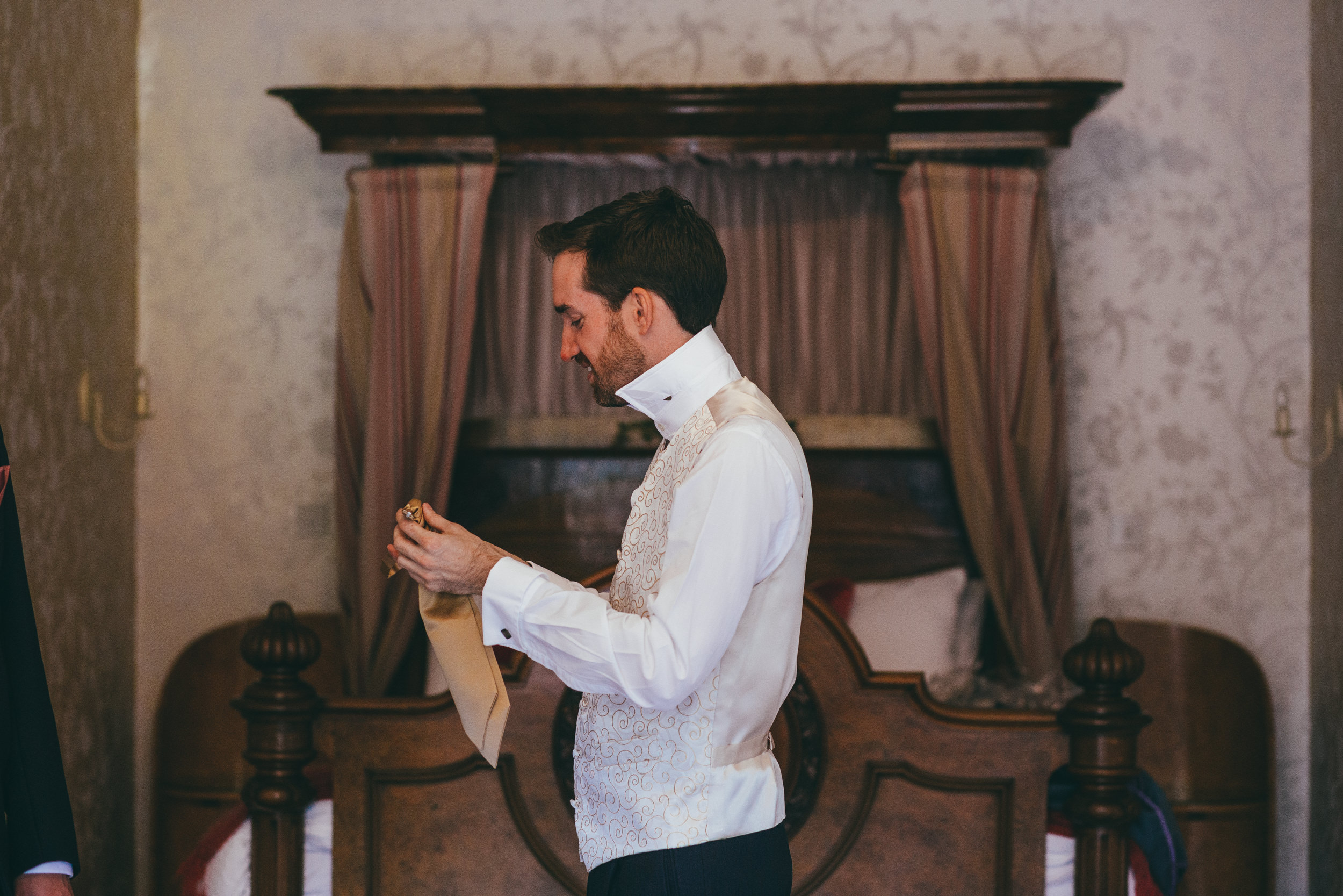 Groom getting dressed at Harlaxton Manor