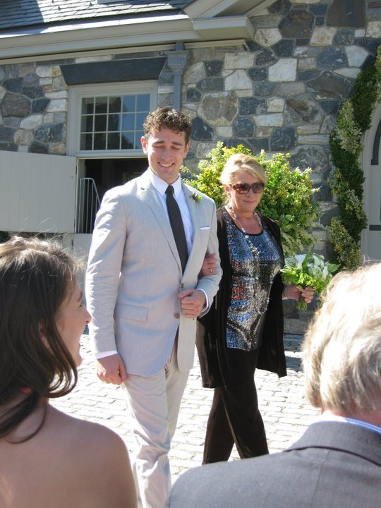 My mom walking with me at my wedding to Tim in 2010. My sister and dad are in the foreground.