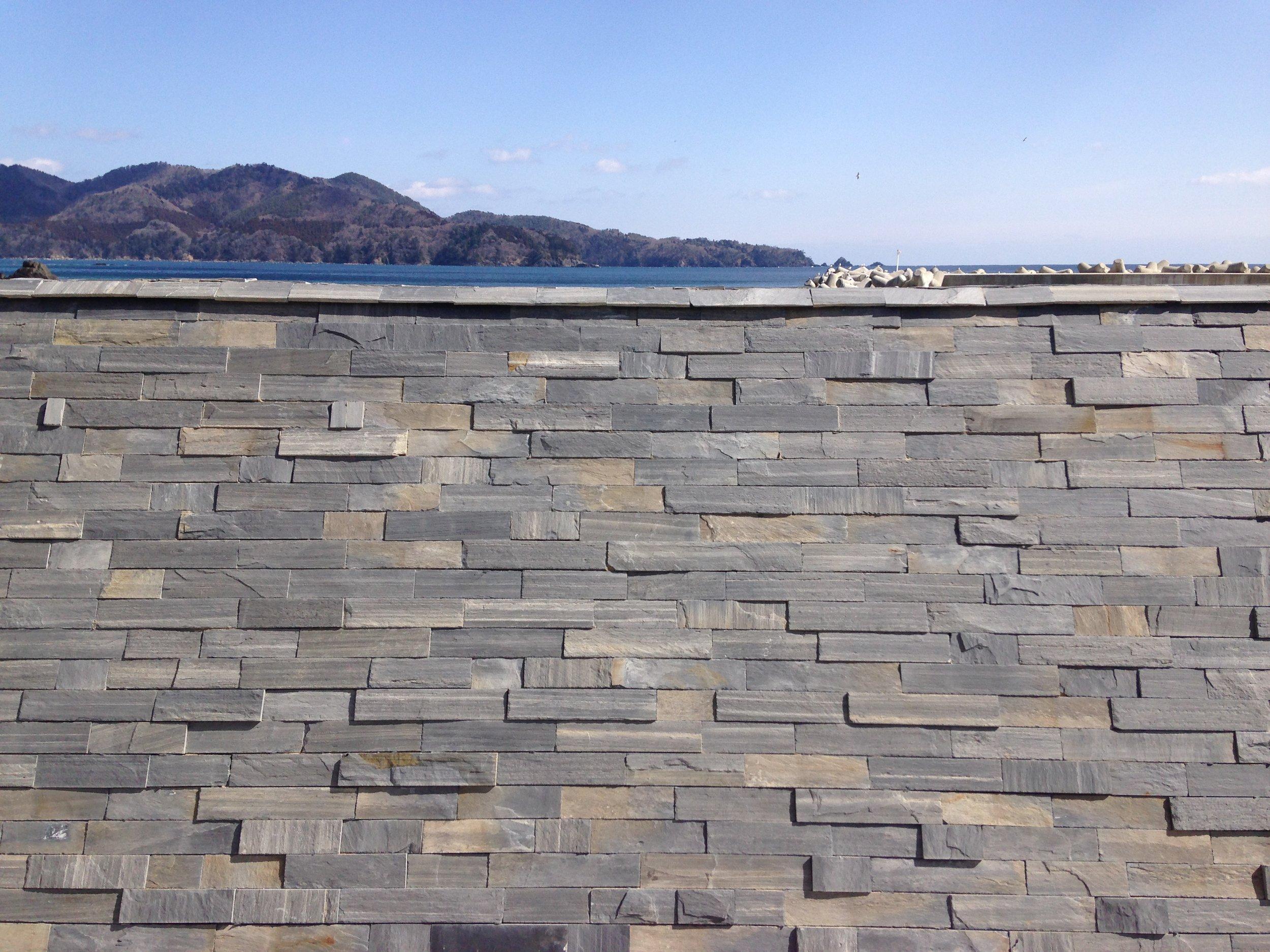 The restored sea wall, decorated with Ogatsu stone, in the seaside hamlet of Namiita, Miyagi Prefecture.