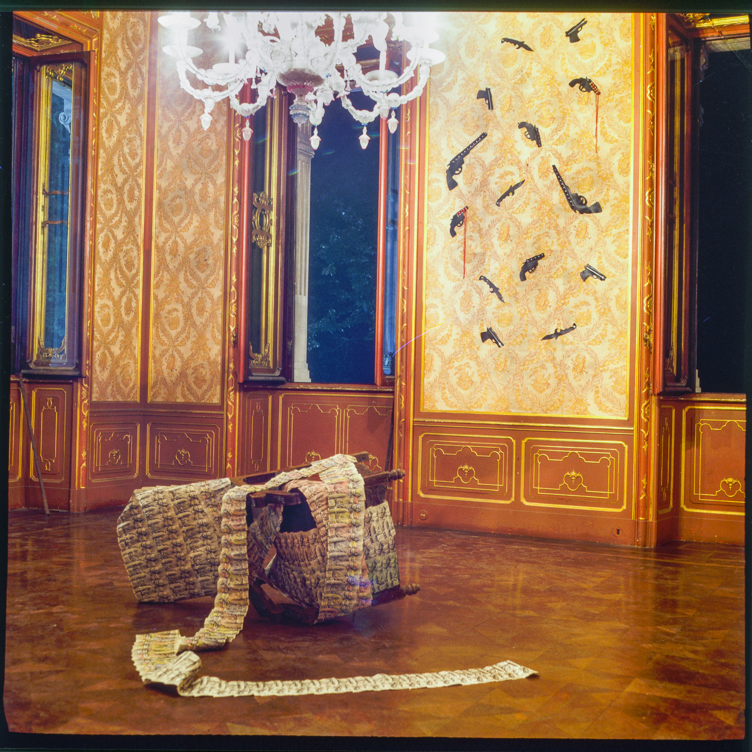 """STANZE"",Villa Chiari (I) 1995  Installation with chair, paper, leatherweapons on wall"
