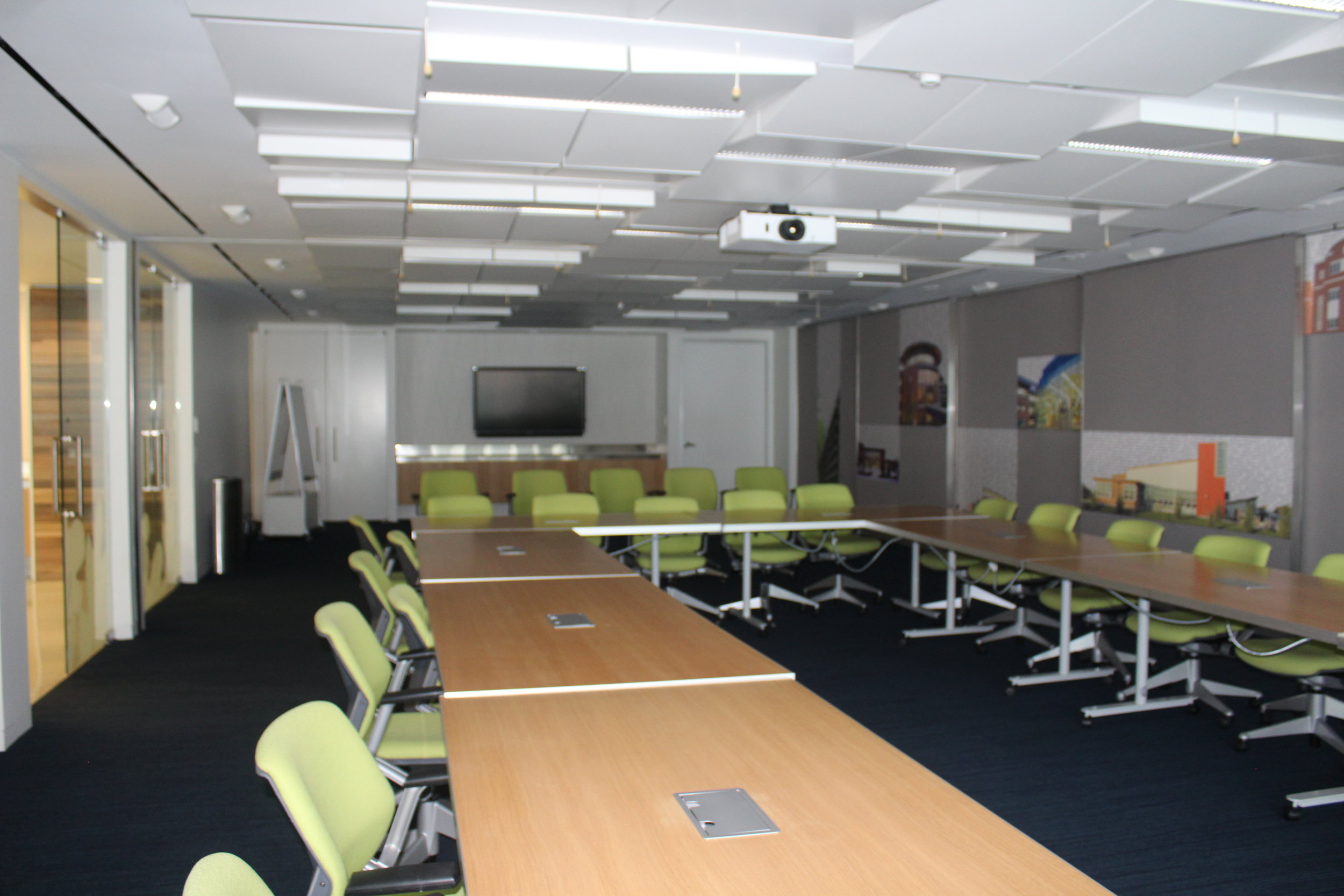 The boardroom is host to many exciting international meetings. In fact, even when we visited, representatives from Shanghai had arrived to meet with USGBC staff. Fun facts: The space contains a demand controlled ventilation system, which adjusts outdoor air intake based on the CO2 of the occupants in the space, providing fresh air as needed. The metal ceiling is made of recycled aluminum and the modulations and perforated backing help with acoustics. By the way, furniture throughout the office is low-emitting, and/or contains recycled content.