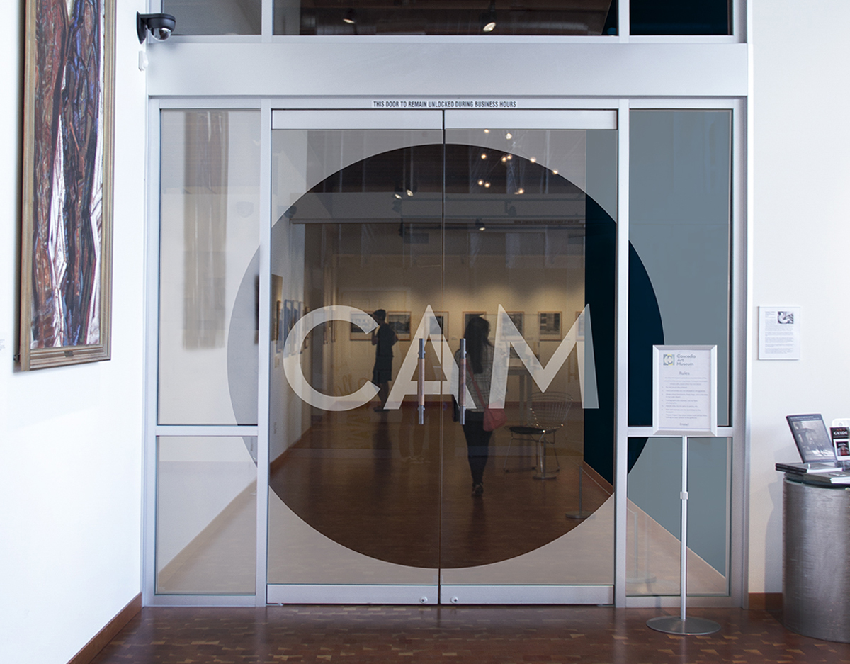 Frosted glass door concept to create more of an experience-focused entrance into the galleries